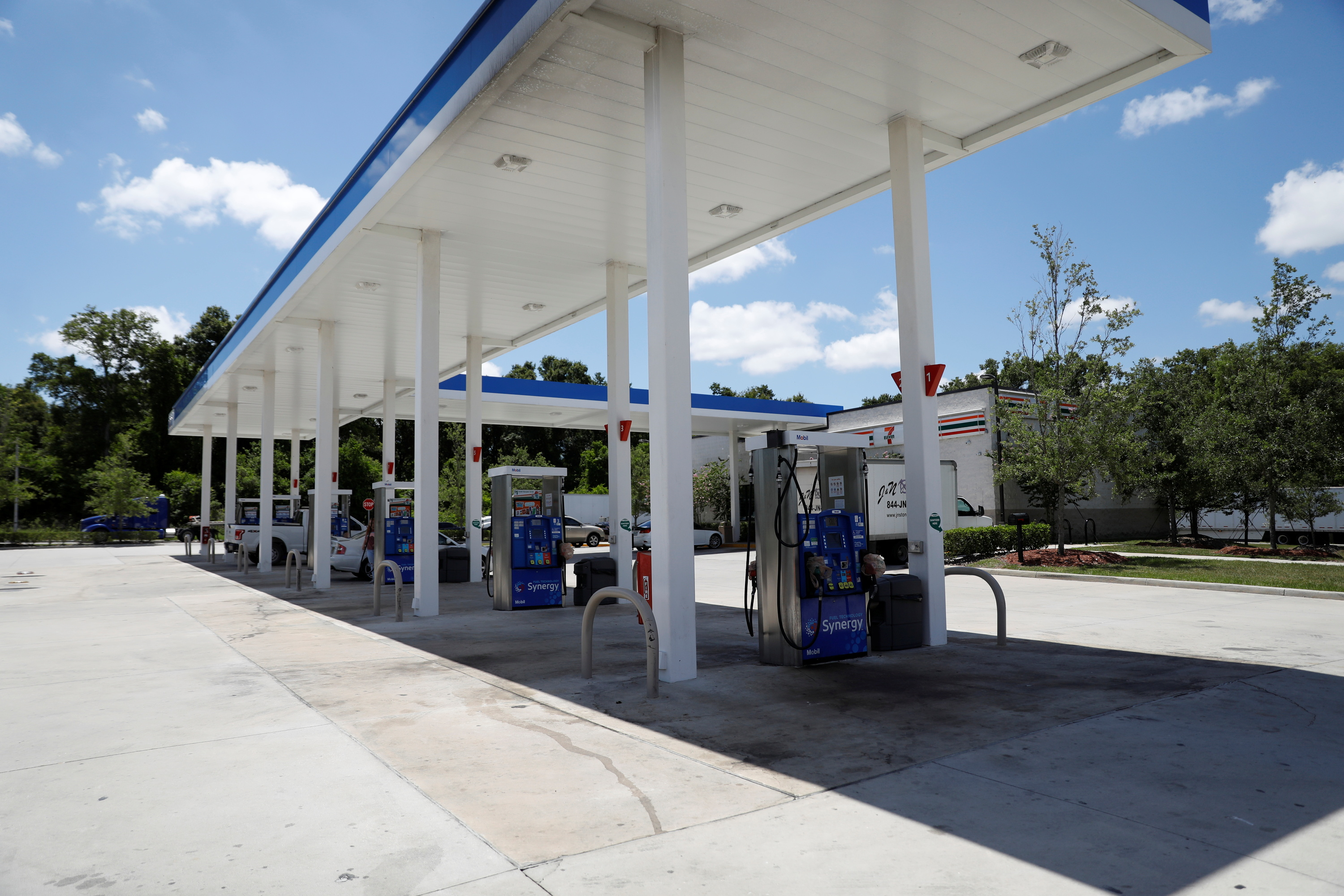 Plastic bags covering fuel pumps to signal no gas is available is seen at a 7-Eleven gas station after a cyberattack crippled the biggest fuel pipeline in the country, run by Colonial Pipeline, in Lakeland, Florida, U.S. May 14, 2021.  REUTERS/Octavio Jones