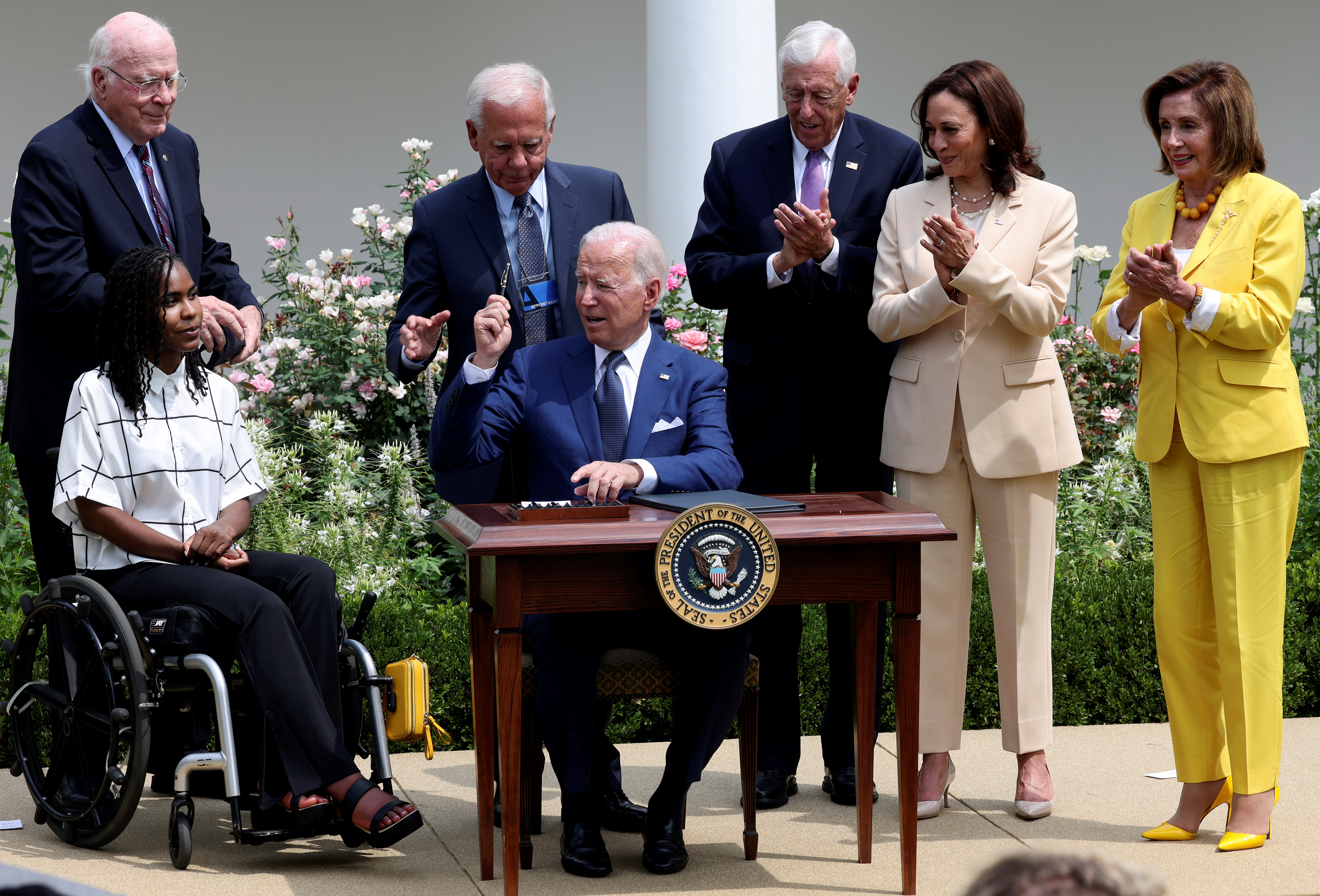 U.S. President Joe Biden is applauded after he signed a proclamation marking the 31st anniversary of the Americans with Disabilities Act (ADA) in the White House Rose Garden in Washington, U.S., July 26, 2021. REUTERS/Evelyn Hockstein