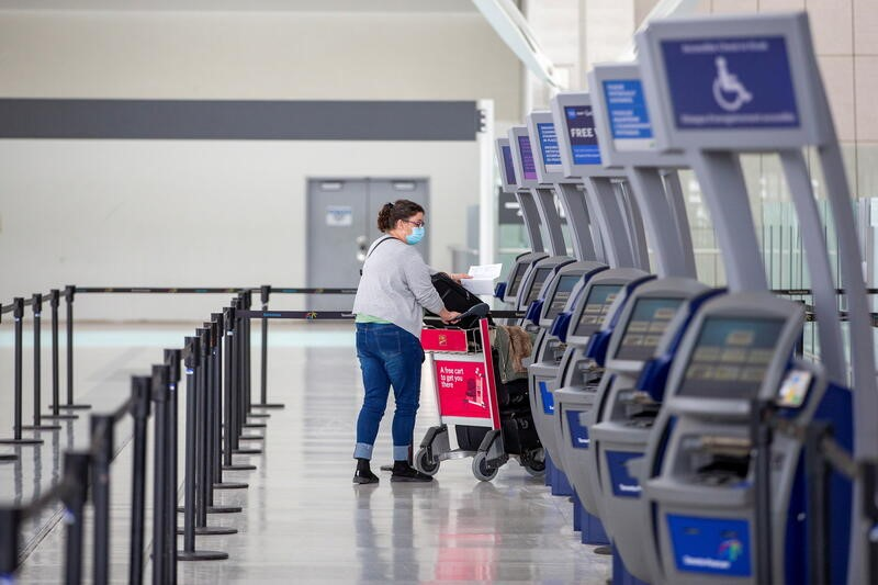 A person wearing a protective mask walks through terminal 1 at Toronto's Pearson Airport after mandatory coronavirus disease (COVID-19) testing took effect for international arrivals in Mississauga, Ontario, Canada February 15, 2021.  REUTERS/Carlos Osorio/File Photo