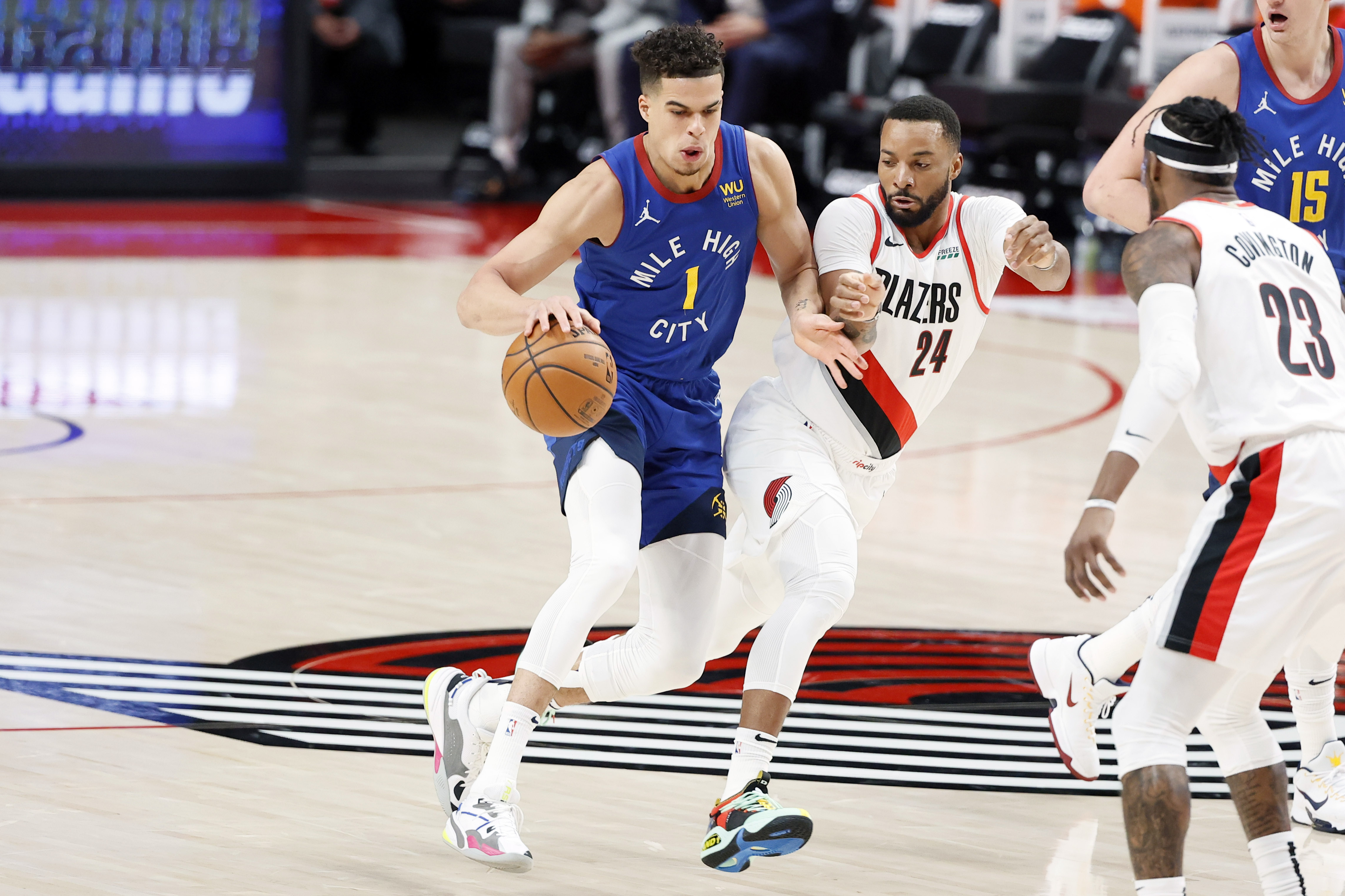 May 27, 2021; Portland, Oregon, USA; Denver Nuggets small forward Michael Porter Jr. (1) dribbles the ball as Portland Trail Blazers small forward Norman Powell (24) defends during the first half of game three in the first round of the 2021 NBA Playoffs at Moda Center. Mandatory Credit: Soobum Im-USA TODAY Sports