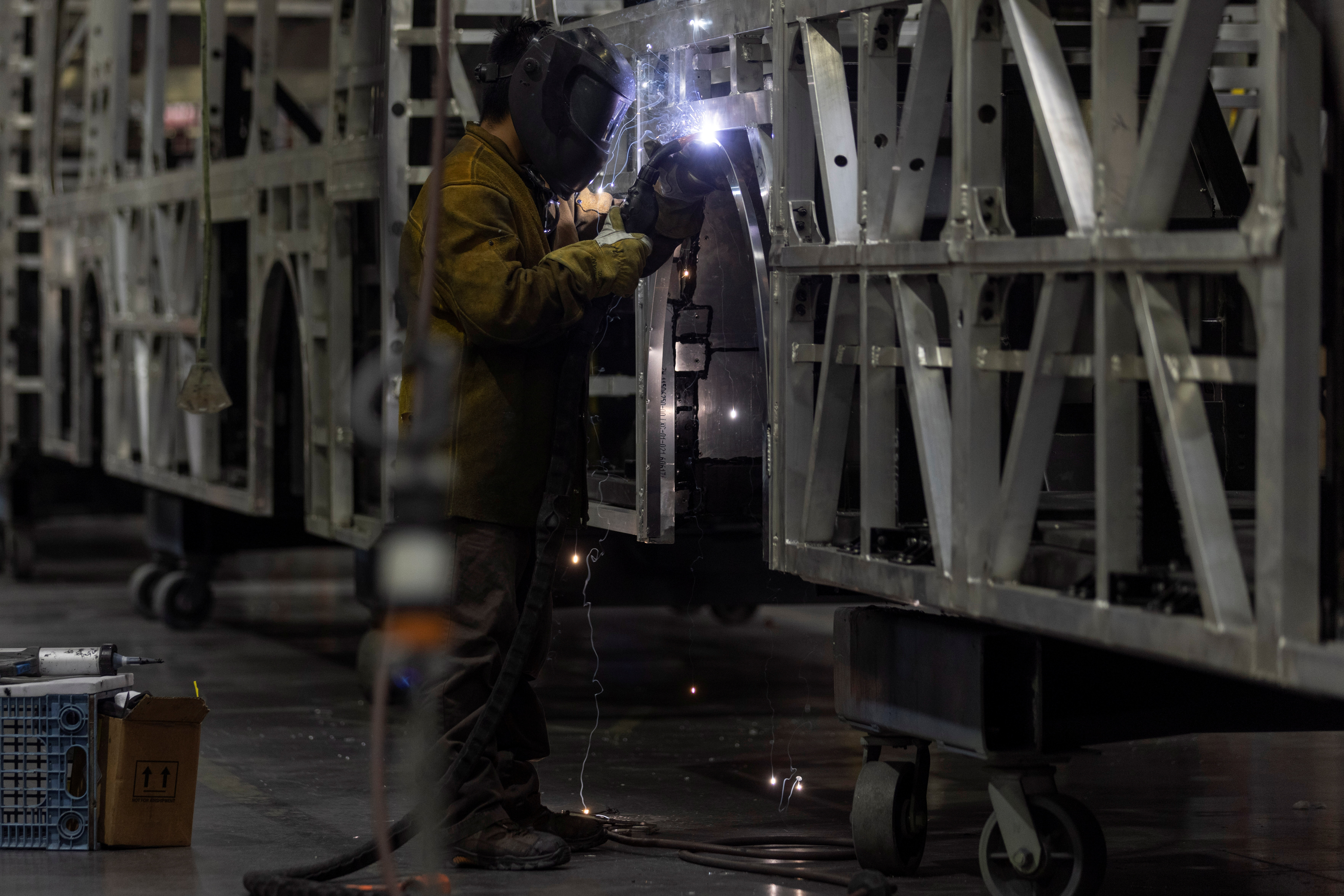 A welder works building a bus frame at the BYD electric bus factory in Lancaster, California, U.S., July 1, 2021. Picture taken July 1, 2021.   REUTERS/Mike Blake