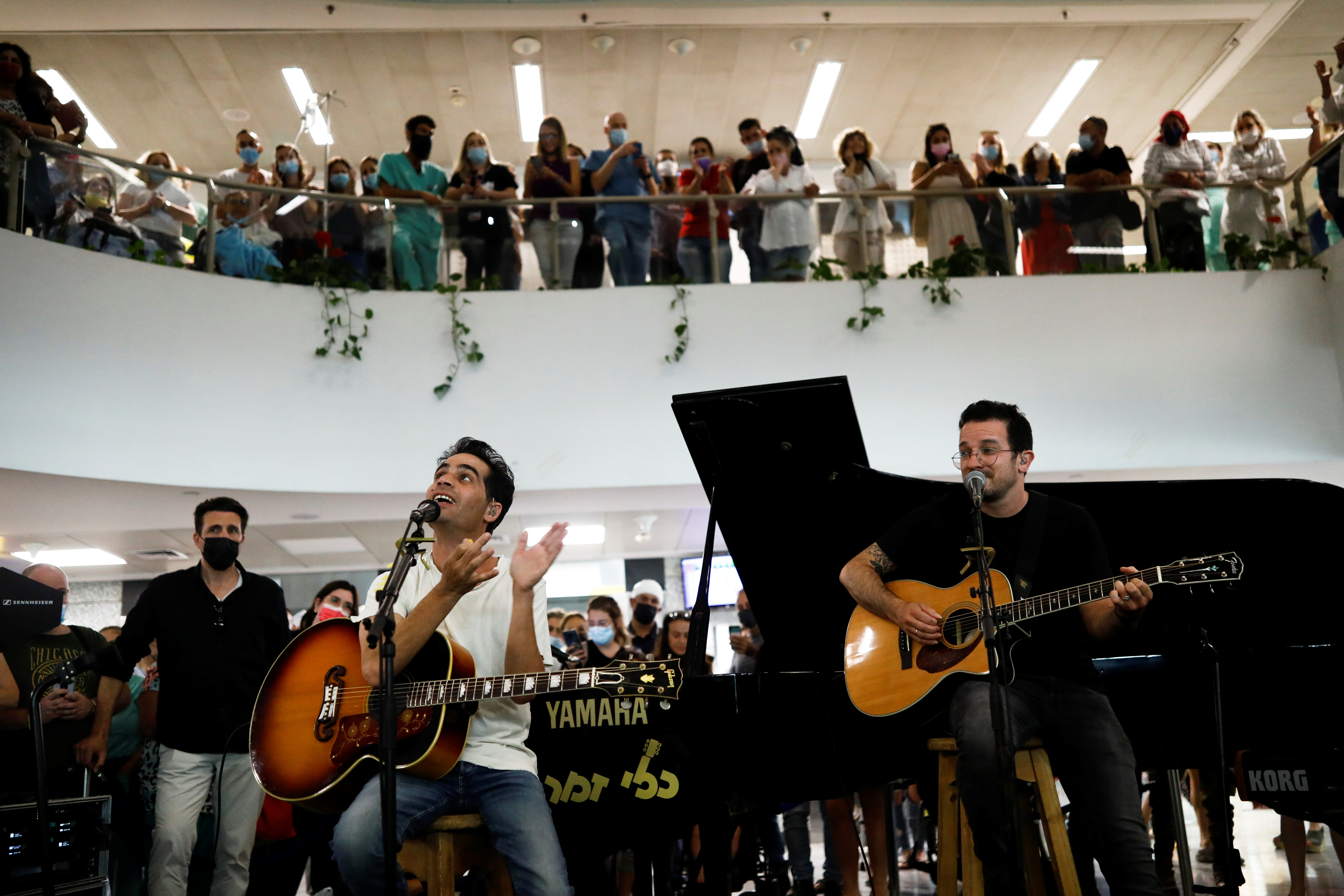 Israeli musician Aviv Geffen performs during an event organised to thank the hospital staff for their work in fighting the coronavirus disease (COVID-19) as Israel further eases its COVID-19 restrictions, at Ichilov hospital, in Tel Aviv, Israel June 1, 2021. REUTERS/Corinna Kern