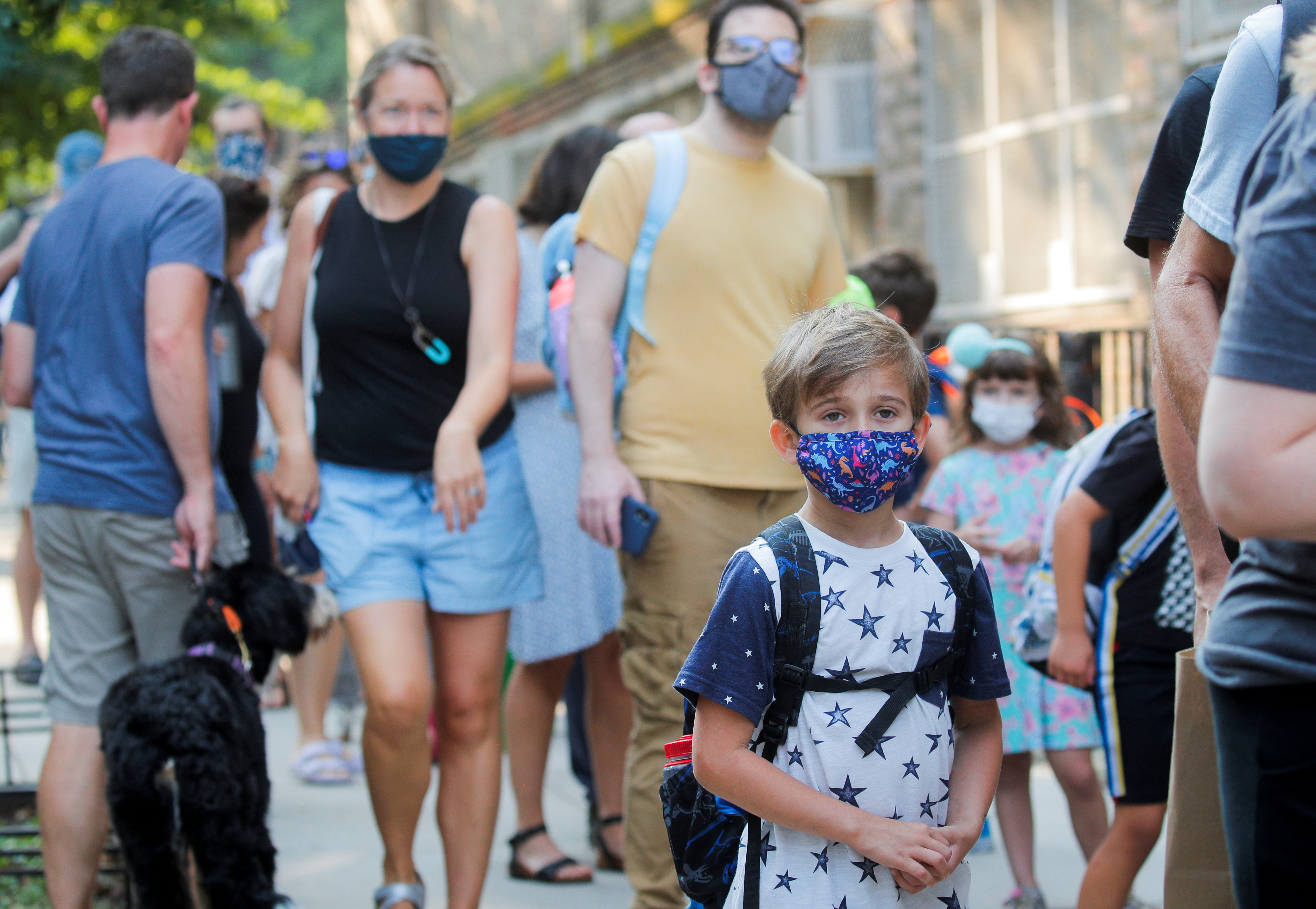 A child wears a face mask on the first day of New York City schools, amid the coronavirus disease (COVID-19) pandemic in Brooklyn, New York, U.S. September 13, 2021. REUTERS/Brendan McDermid