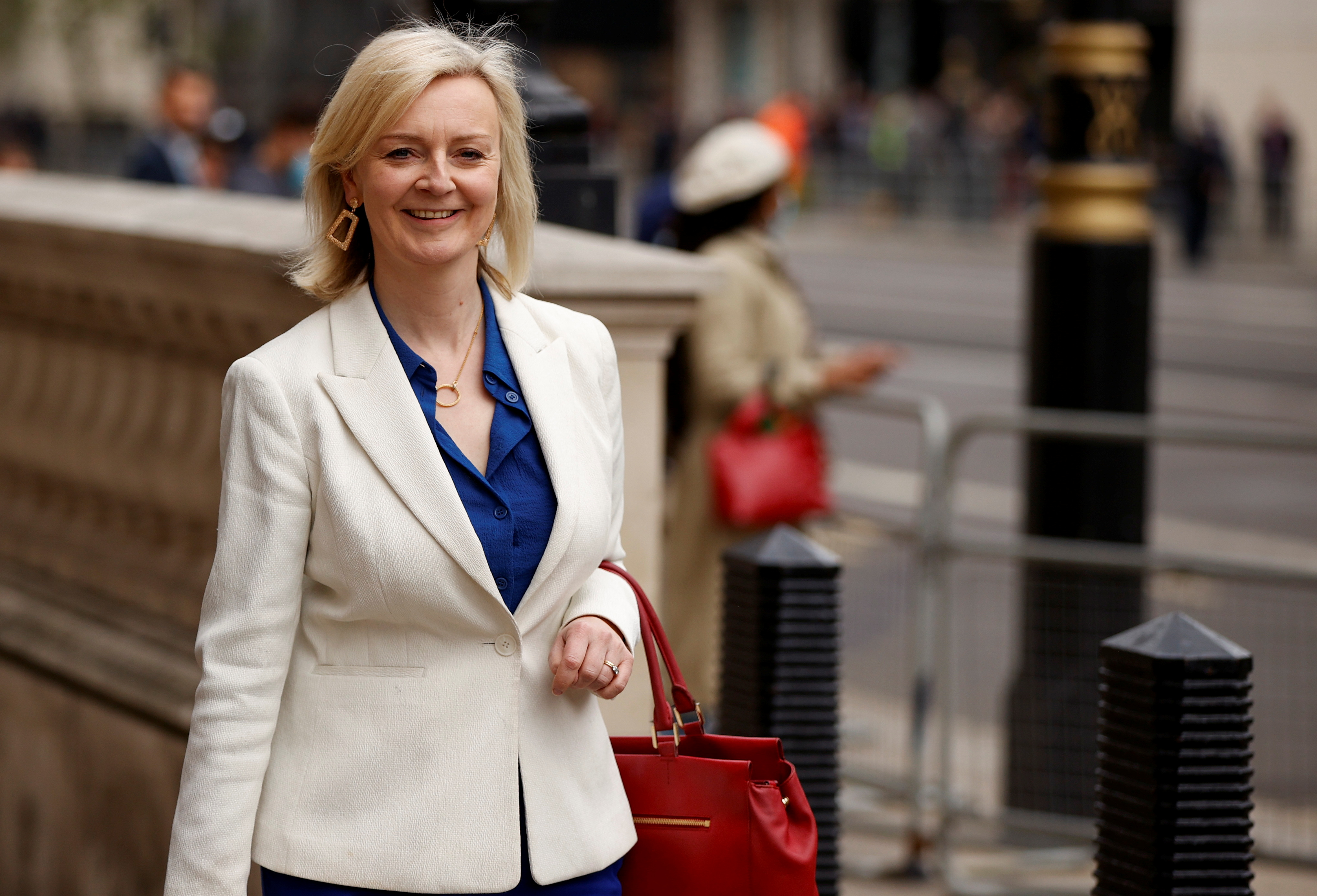 Britain's Trade Minister Liz Truss walks after the ceremony of State Opening of Parliament at the Palace of Westminster, amid the coronavirus disease (COVID-19) restrictions, in London, Britain, May 11, 2021. REUTERS/John Sibley/Files