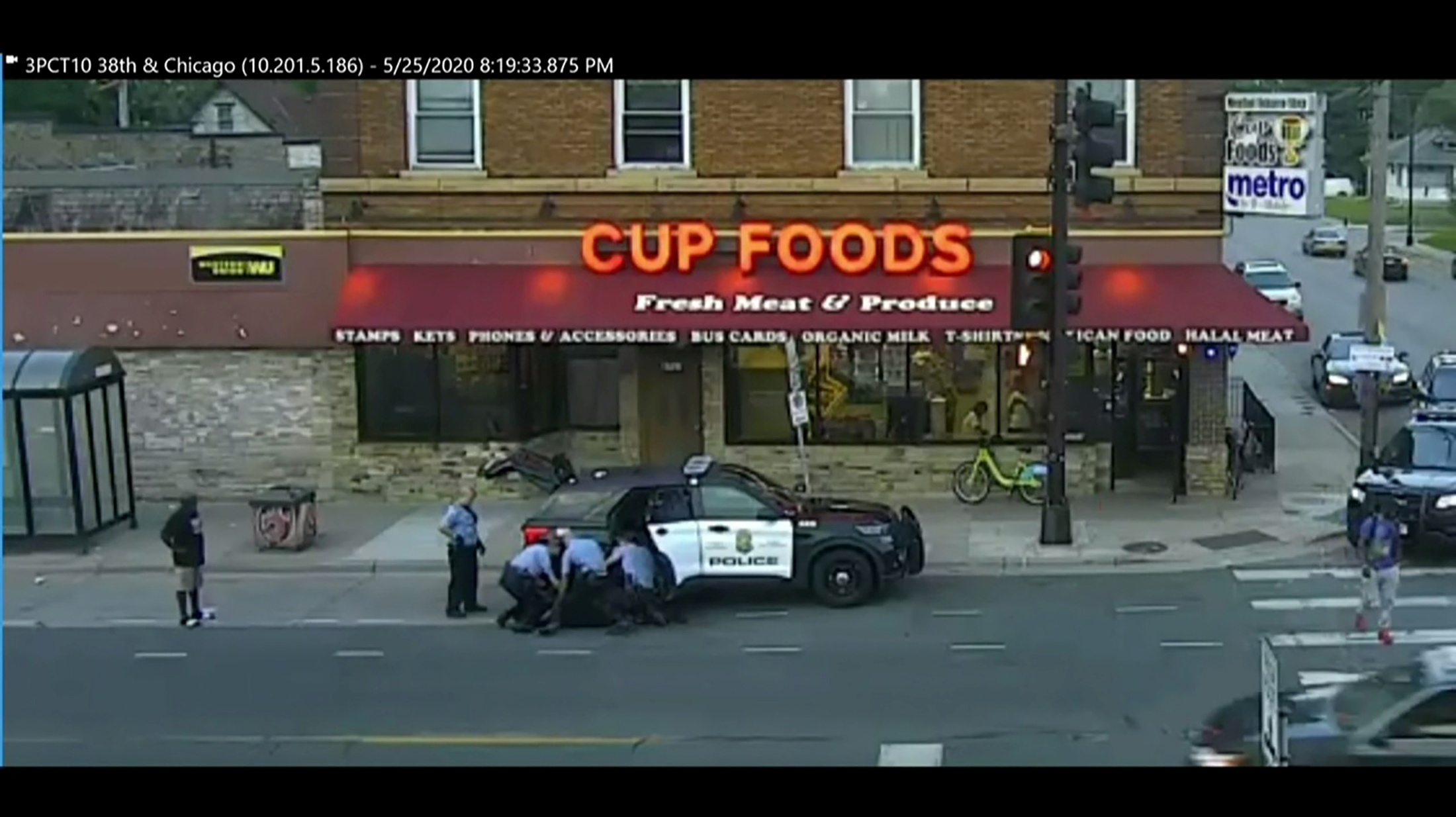 Minneapolis police officers arrest George Floyd in a surveillance video taken May 25, 2020 and shown to jurors during the trial of former Minneapolis police officer Derek Chauvin for second-degree murder, third-degree murder and second-degree manslaughter in the death of George Floyd in Minneapolis, Minnesota, U.S. March 29, 2021 in a still image from video.  Pool via REUTERS