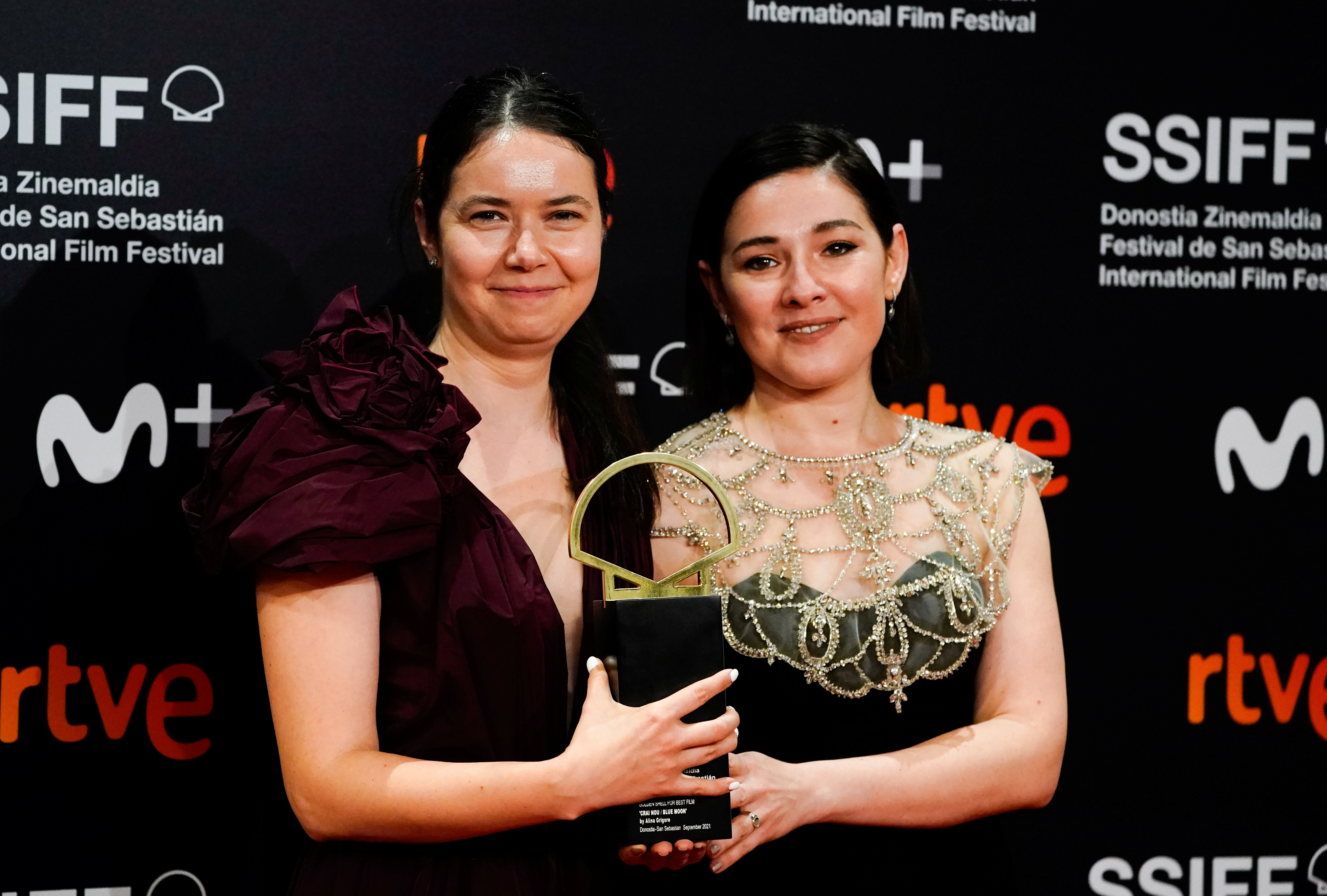 Director and producer Alina Grigore and producer Gabi Suciu pose with the Concha de Oro (Golden Shell) award for best film for the feature film