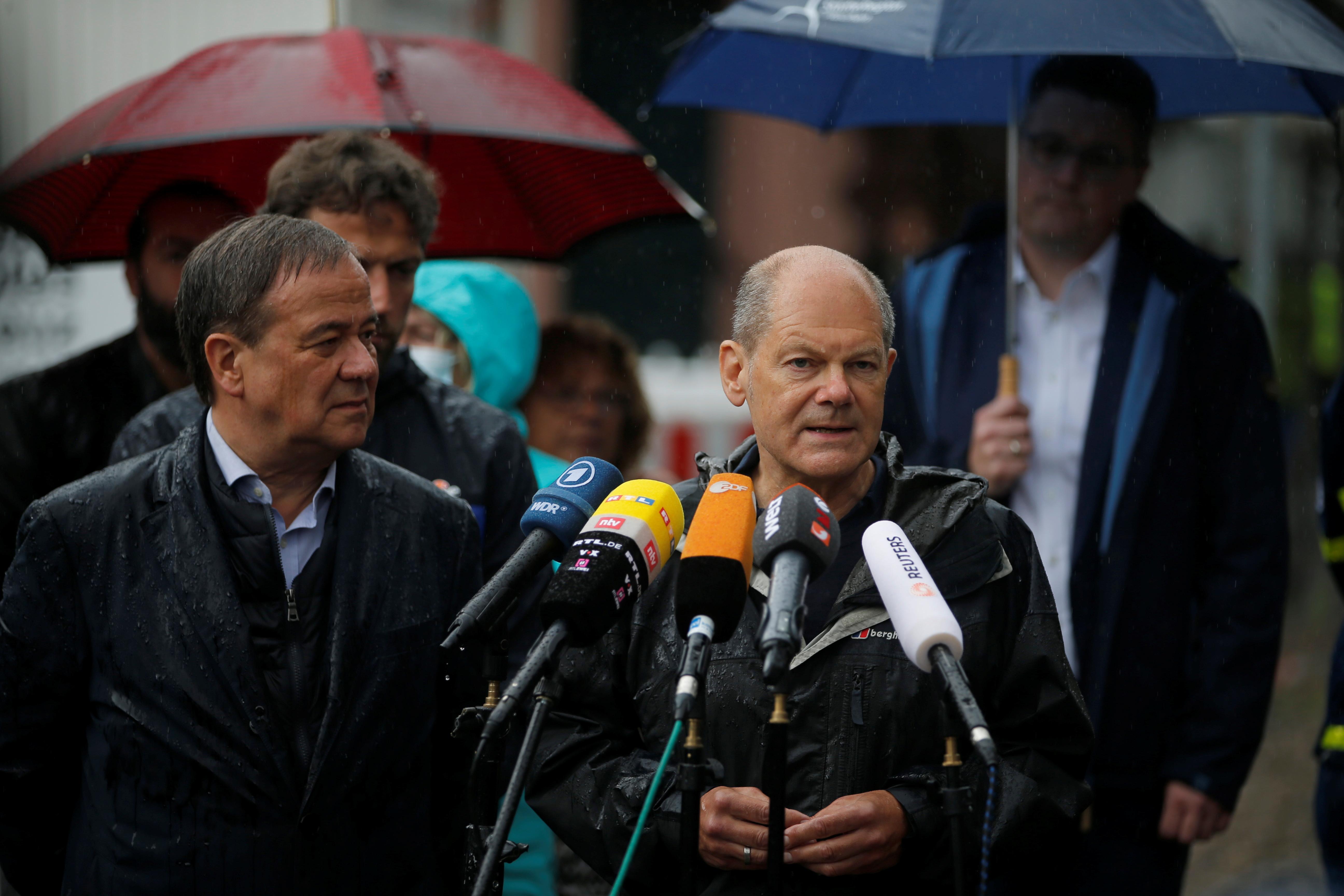 German Finance minister Olaf Scholz (SPD) speaks during a visit with Minister-president of German state Northrhine Westphalia, Armin Laschet (CDU) following heavy rainfalls in Stolberg, Germany, August 3, 2021. REUTERS/Leon Kuegeler
