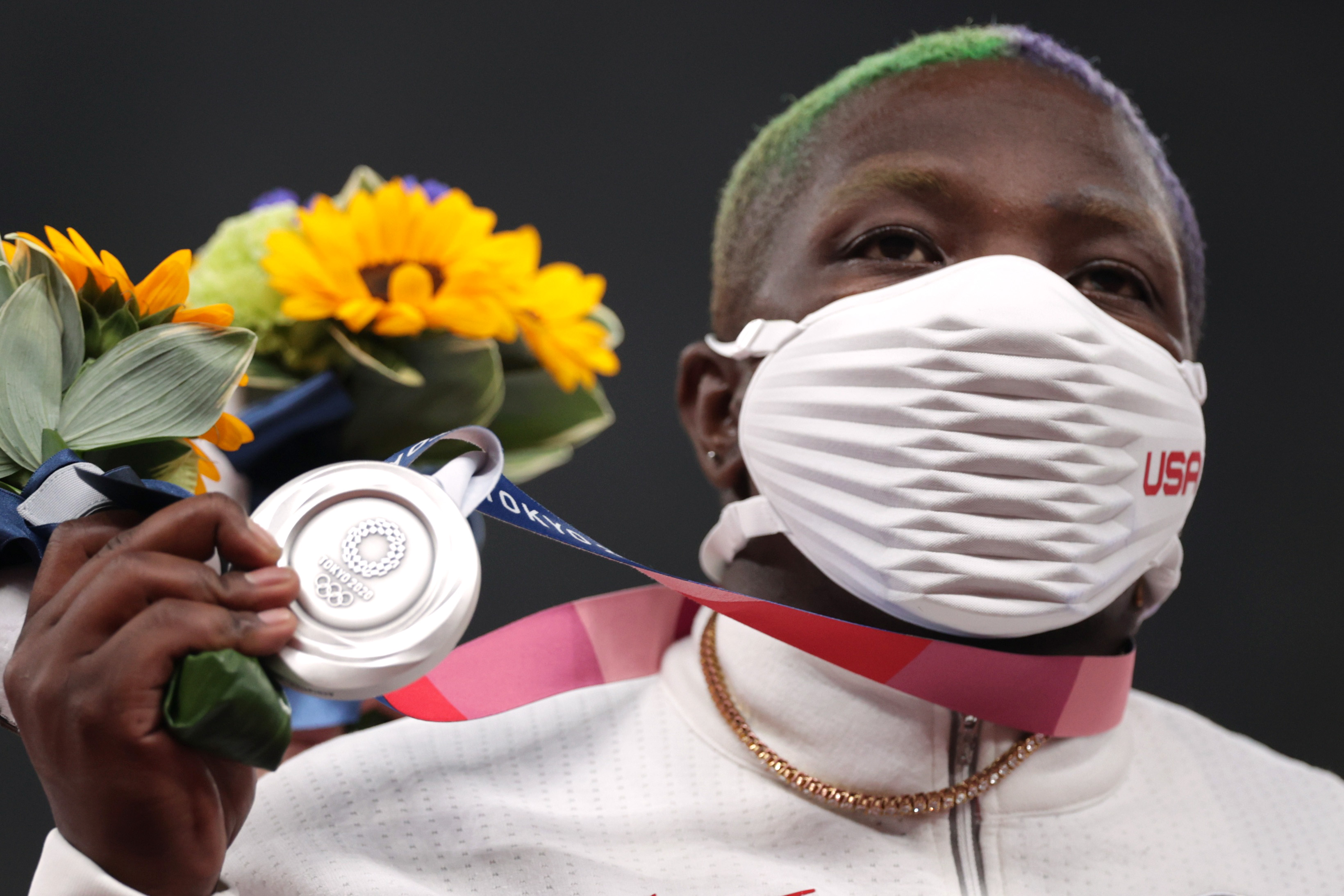 Tokyo 2020 Olympics - Athletics - Women's Shot Put - Medal Ceremony - Olympic Stadium, Tokyo, Japan – August 1, 2021. Silver medallist, Raven Saunders of the United States wearing a protective face mask poses on the podium REUTERS/Hannah Mckay