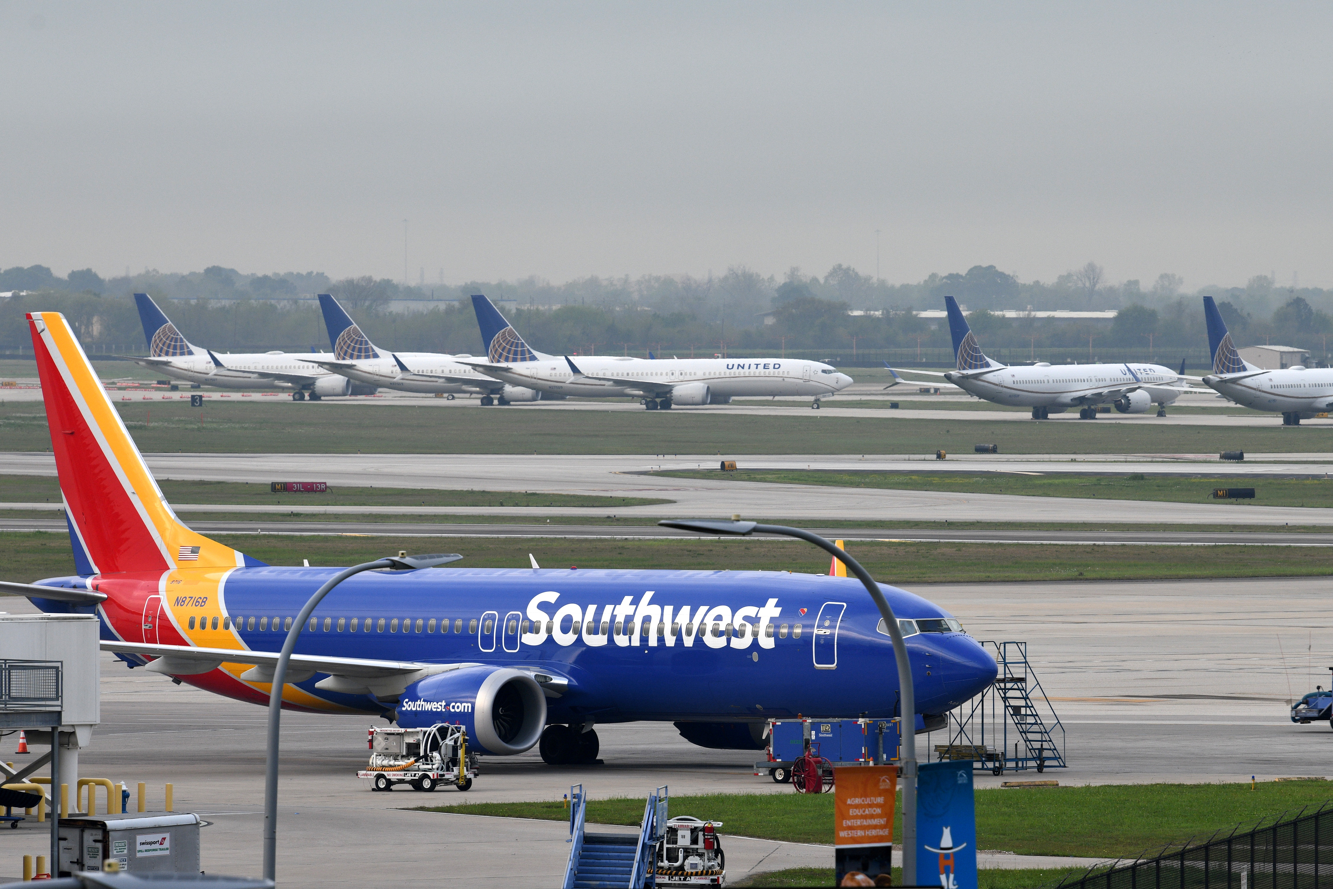 A Southwest Airlines Boeing 737 MAX 8 aircraft is pictured in front of United Airlines planes, including Boeing 737 MAX 9 models, at William P. Hobby Airport in Houston, Texas, U.S., March 18, 2019.  REUTERS/Loren Elliott/File Photo