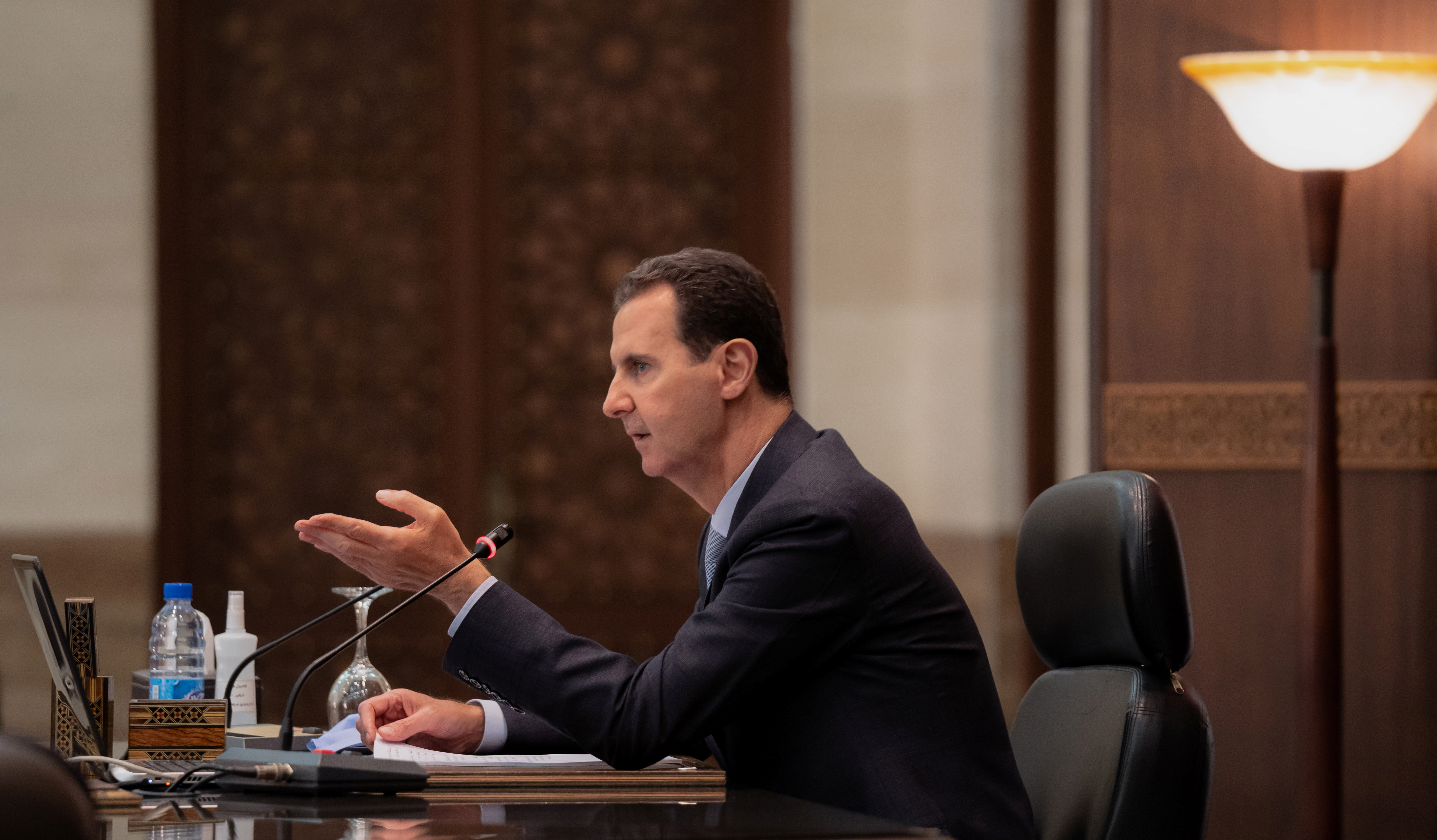 Syria's President Bashar al-Assad speaks as he meets with the Syrian cabinet in Damascus, Syria in this handout picture released by Sana on March 30, 2021. SANA/Handout via REUTERS