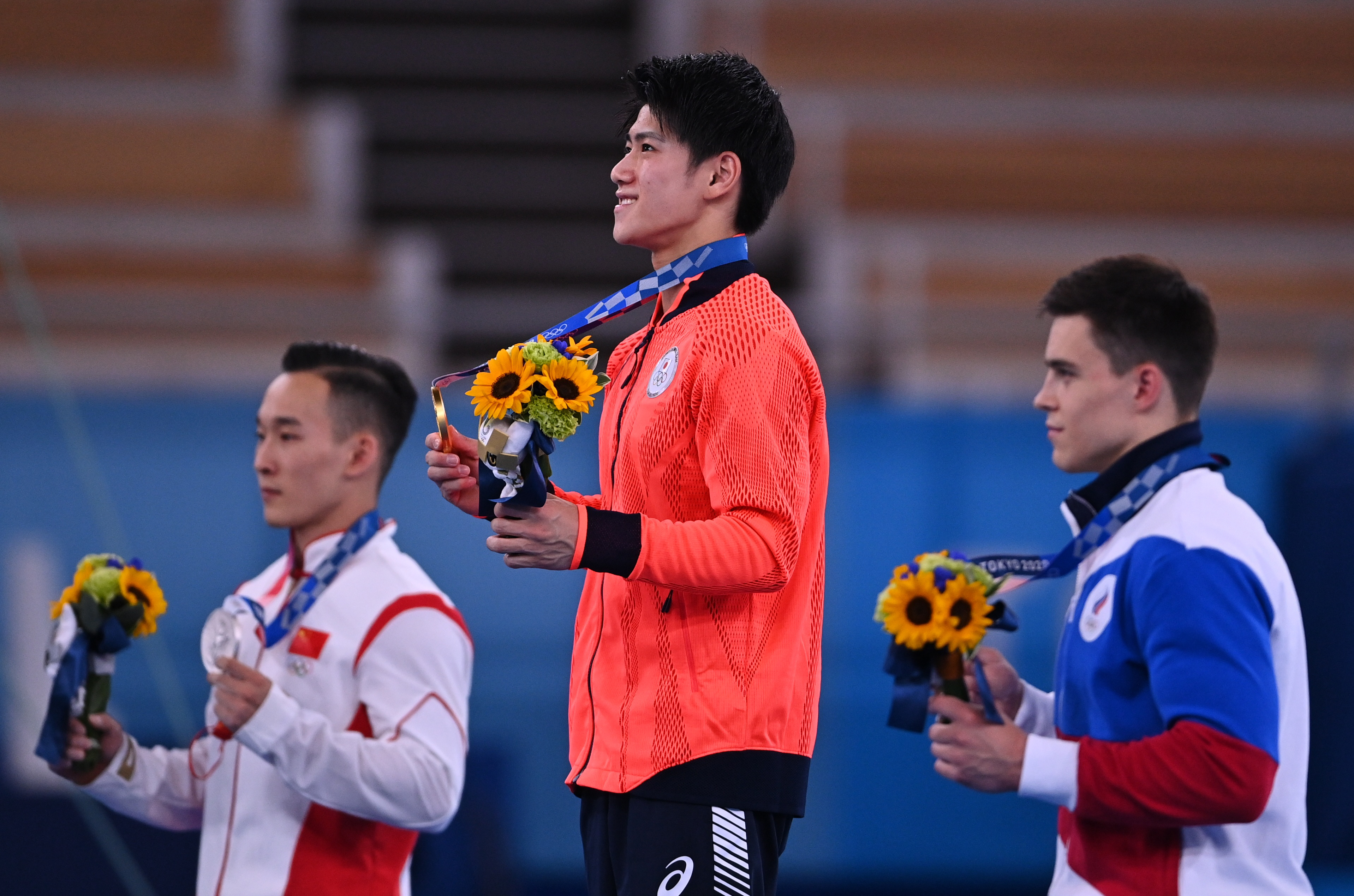 Tokyo 2020 Olympics - Gymnastics - Artistic - Men's Individual All-Around - Medal Ceremony - Ariake Gymnastics Centre, Tokyo, Japan - July 28, 2021. Gold medallist Daiki Hashimoto of Japan poses on the podium with silver medallist Xiao Ruoteng of China and bronze medallist Nikita Nagornyy of the Russian Olympic Committee REUTERS/Dylan Martinez