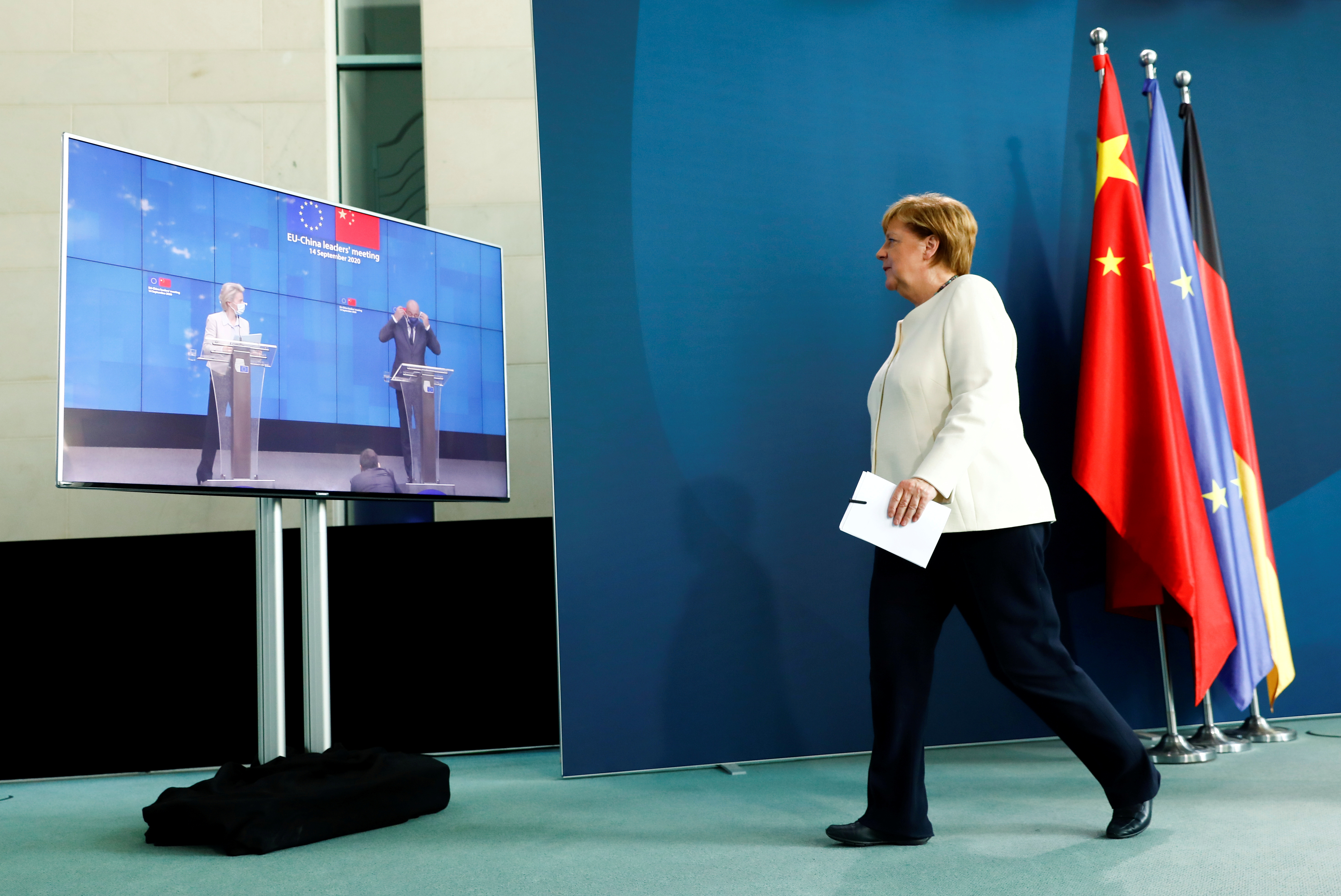 German Chancellor Angela Merkel walks after holding a video news conference with European Council President Charles Michel and European Commission President Ursula von der Leyen following a virtual summit with China's President Xi Jinping, at the Chancellery in Berlin, September 14, 2020. REUTERS/Michele Tantussi/Pool/File Photo