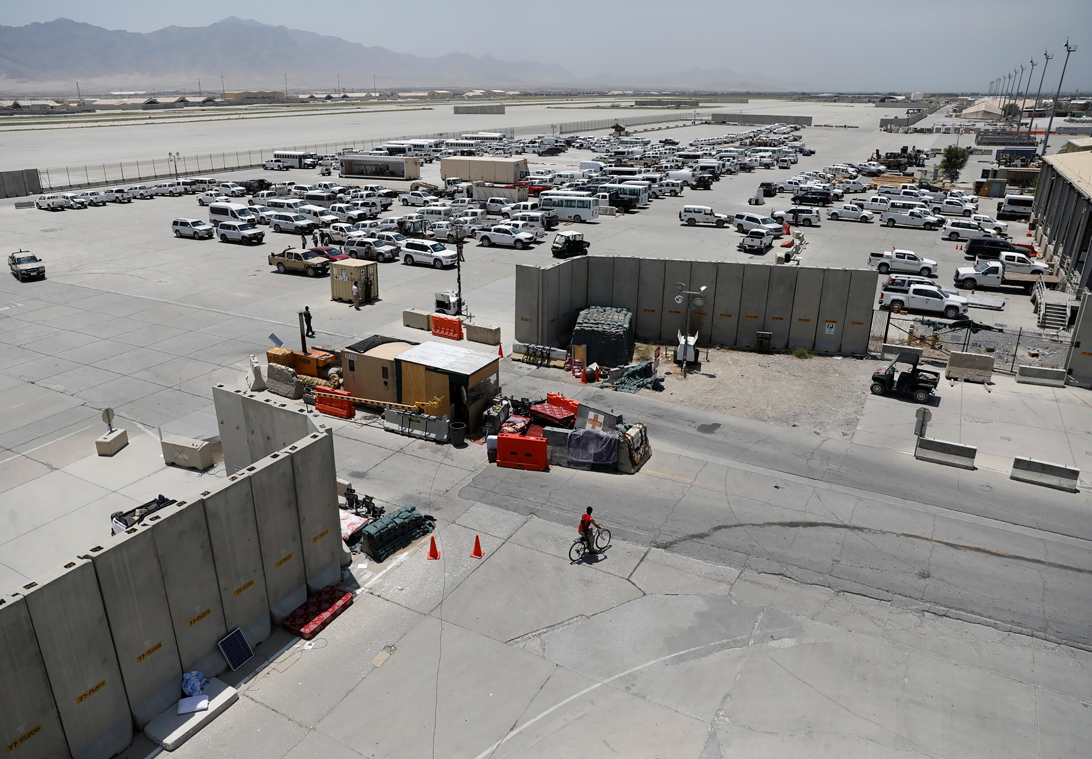 Parked vehicles are seen in Bagram U.S. air base, after American troops vacated it, in Parwan province, Afghanistan July 5, 2021. REUTERS/Mohammad Ismail