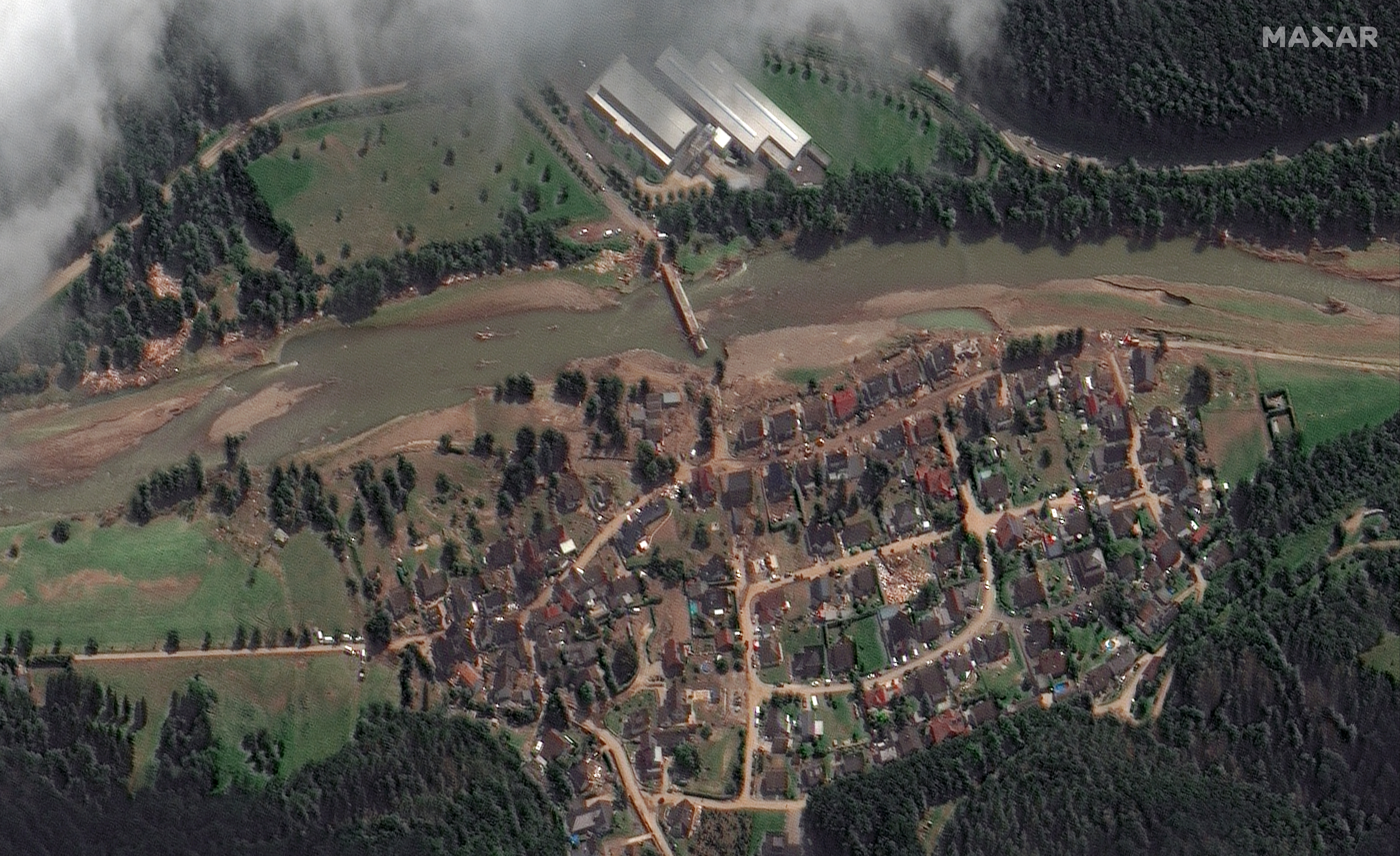 A satellite view shows the city of Liers affected by floods caused by heavy rainfalls, Germany July 18, 2021. Satellite image ©2021 Maxar Technologies/ Handout via REUTERS