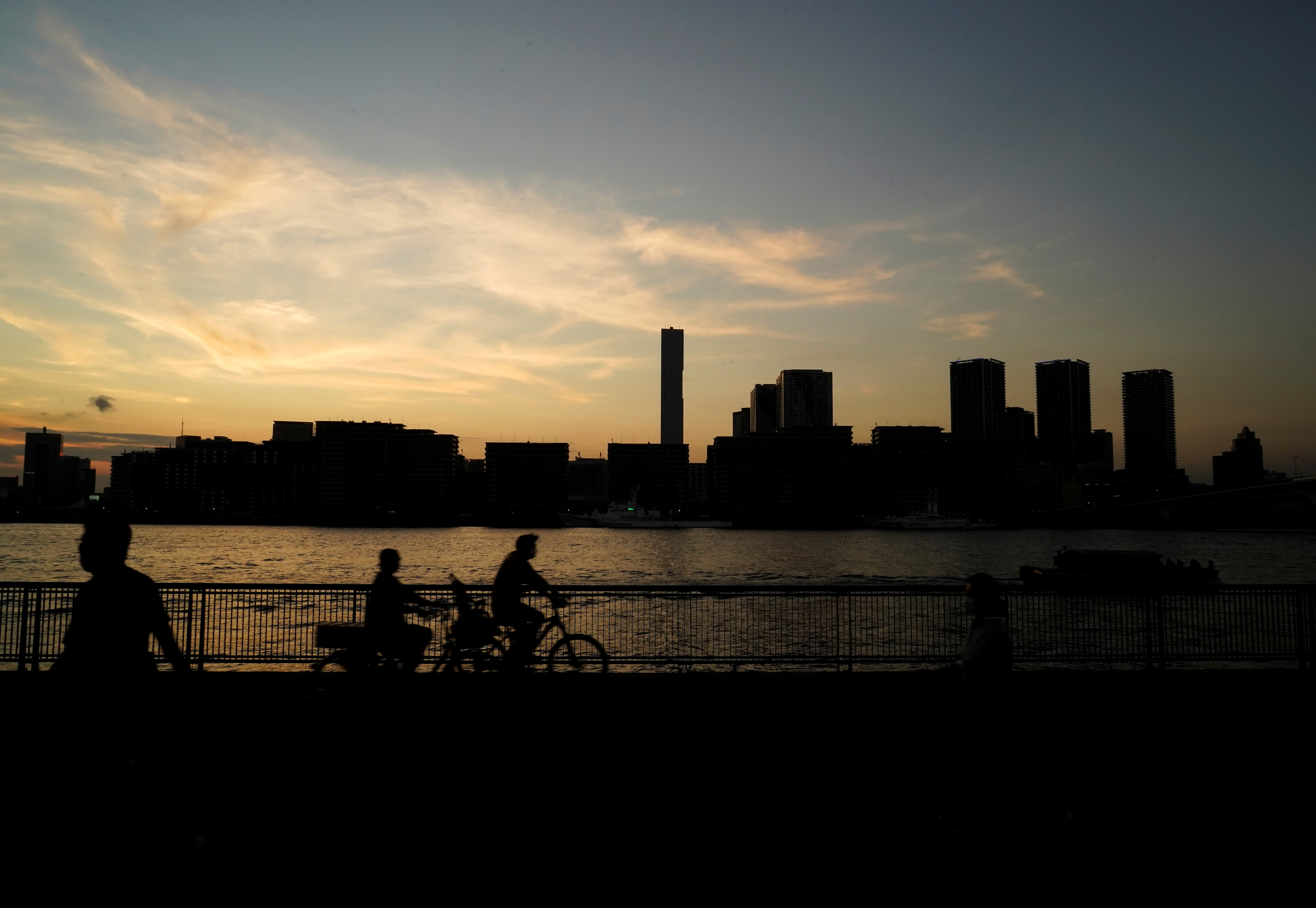 A silhouette of the 2020 Tokyo Olympic Games Athletes' Village is seen in Tokyo, Japan, July 19, 2021. REUTERS/Naoki Ogura