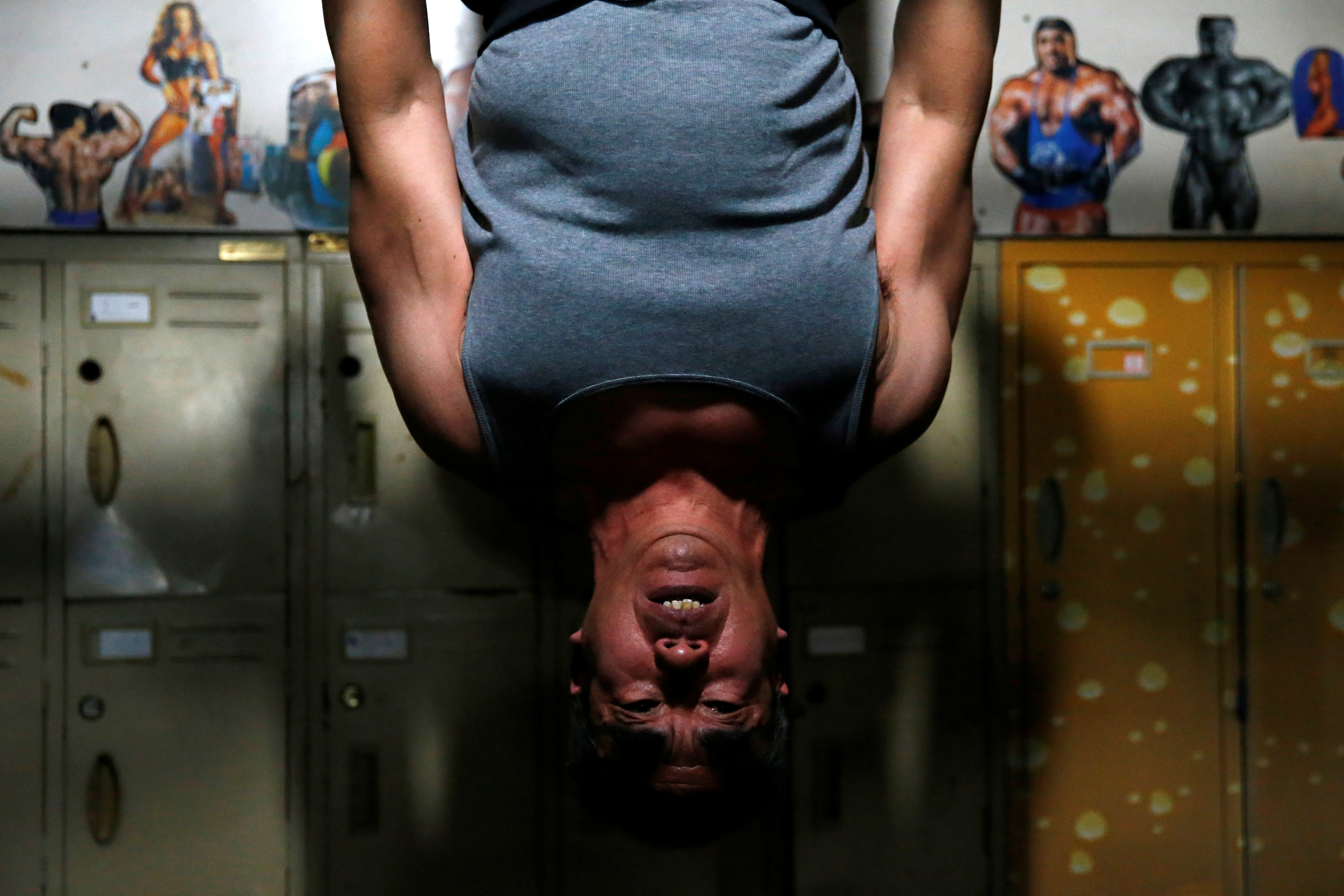 Zhao Shuyuan, 61, exercises at a gym which has been turned from a bicycle shed inside a residential compound in the southwest of Beijing, China April 8, 2021. REUTERS/Tingshu Wang