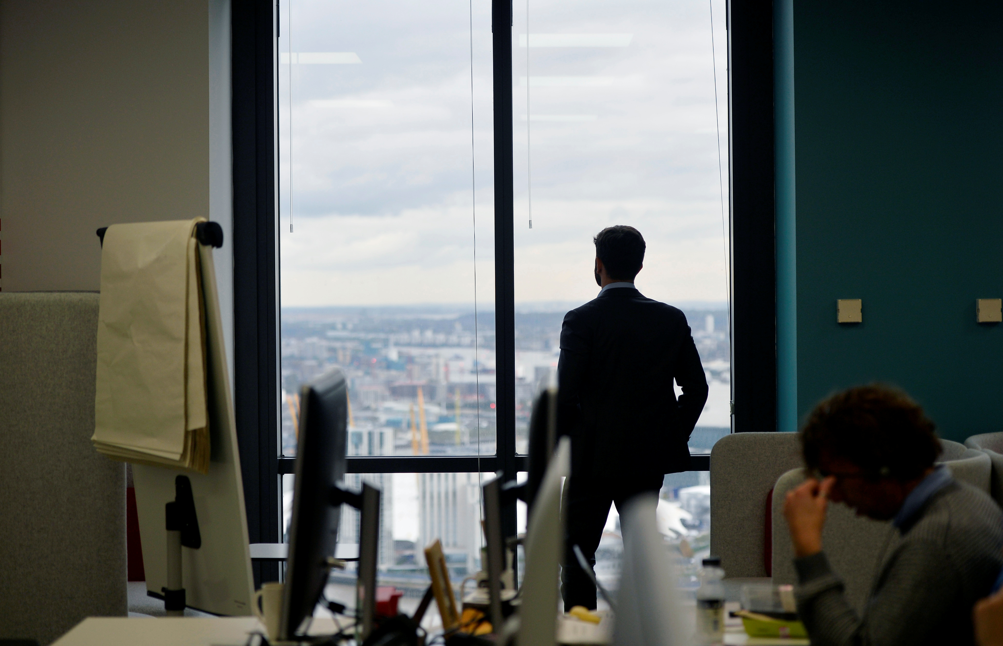 A UBS employee works in the UBS