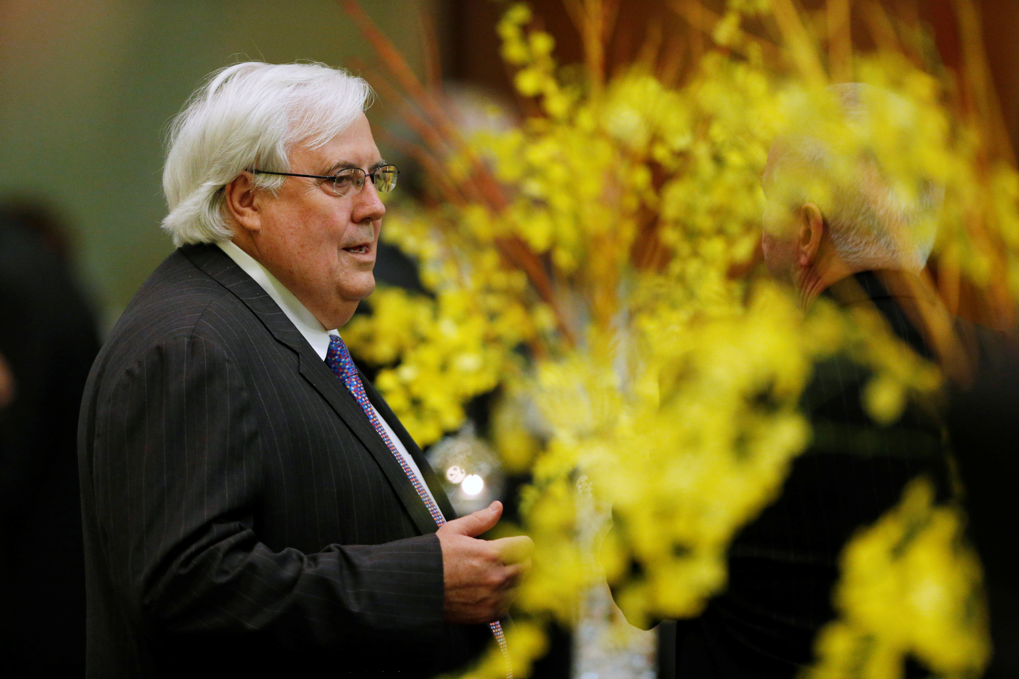 Australian businessman Clive Palmer is pictured during a dinner at Parliament House in Canberra, July 8, 2014. REUTERS/Jason Reed