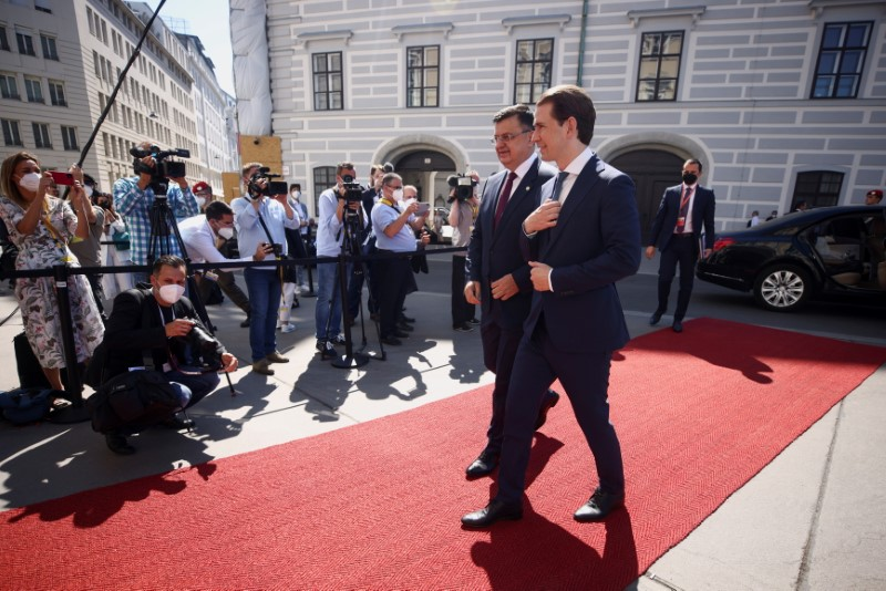 Austria's Chancellor Sebastian Kurz welcomes Chairman of the Council of Ministers of Bosnia and Herzegovina Zoran Tegeltija to the Western Balkans conference, outside the Chancellery in Vienna, Austria June 18, 2021. REUTERS/Lisi Niesner