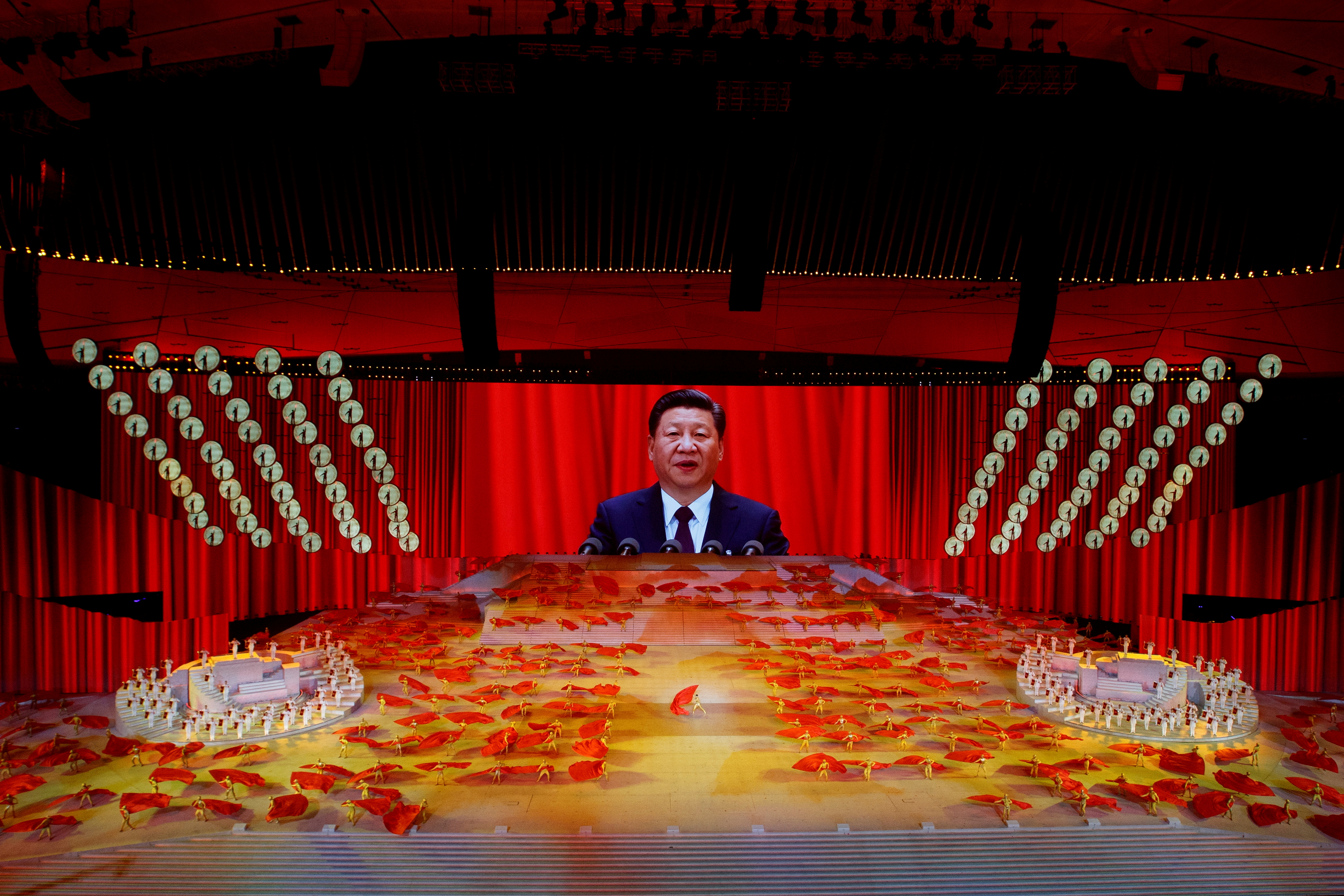 A screen shows Chinese President Xi Jinping during a show commemorating the 100th anniversary of the founding of the Communist Party of China at the National Stadium in Beijing, China June 28, 2021. REUTERS/Thomas Peter