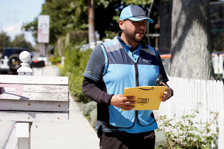 Joseph Alvarado makes deliveries for Amazon during the outbreak of the coronavirus disease (COVID-19) in Costa Mesa, California, U.S., March 23, 2020.  REUTERS/Alex Gallardo/File Photo