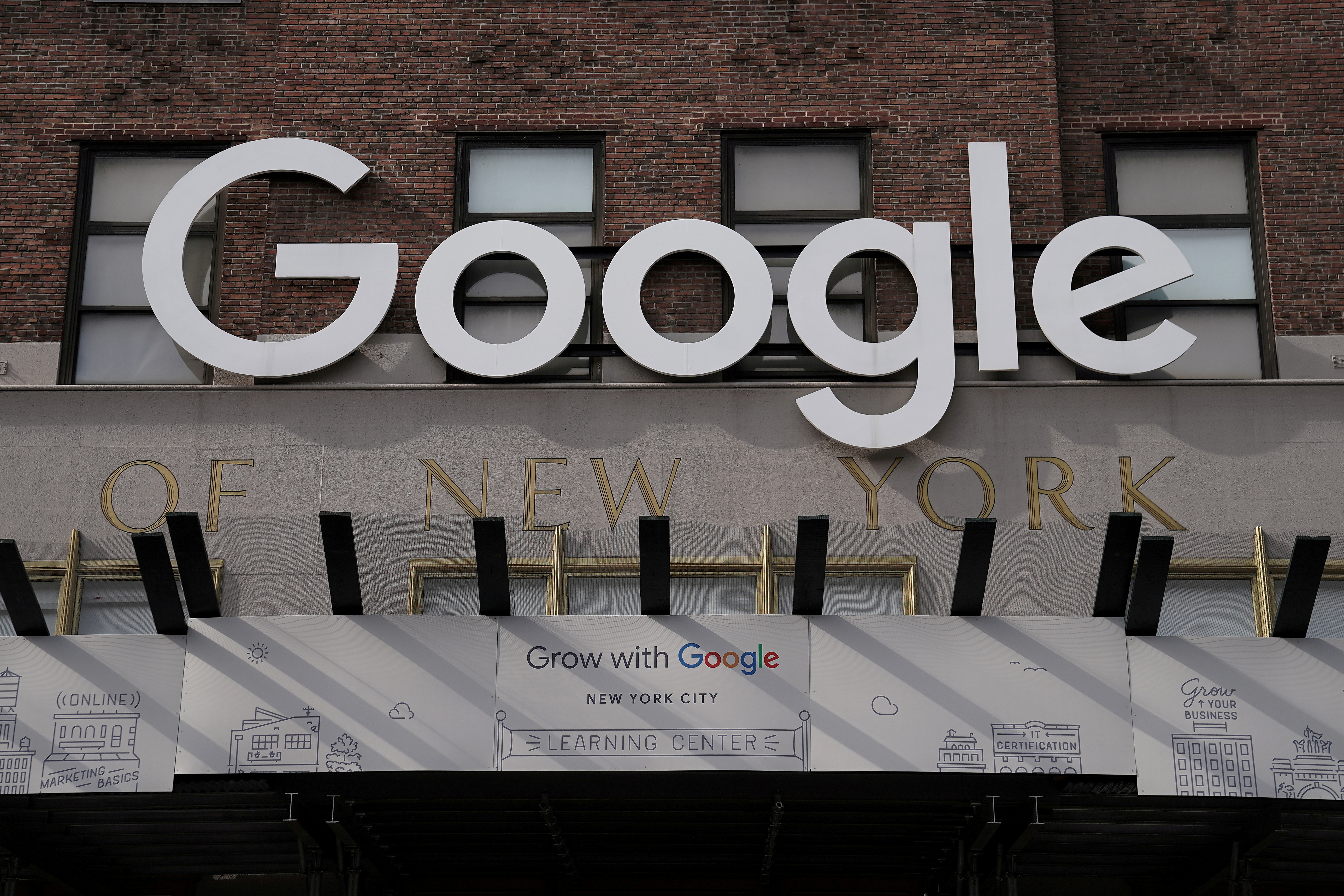 FILE PHOTO: A Google sign is pictured on a Google building in the Manhattan borough of New York City, New York, U.S., October 20, 2020. REUTERS/Carlo Allegri/File Photo