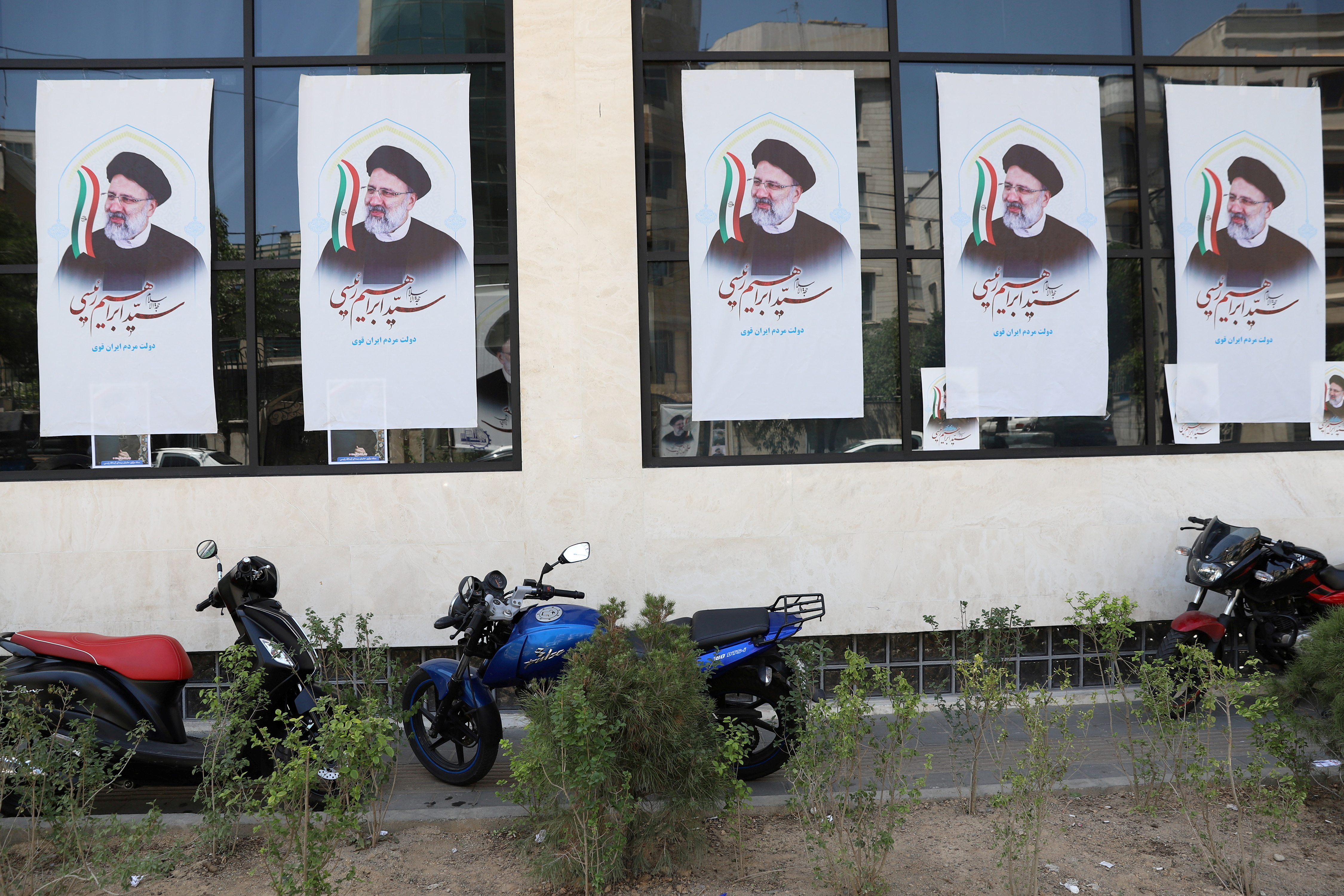Posters of presidential candidate Ebrahim Raisi are seen at a campaign center in Tehran, Iran June 4, 2021. Majid Asgaripour/WANA (West Asia News Agency) via REUTERS
