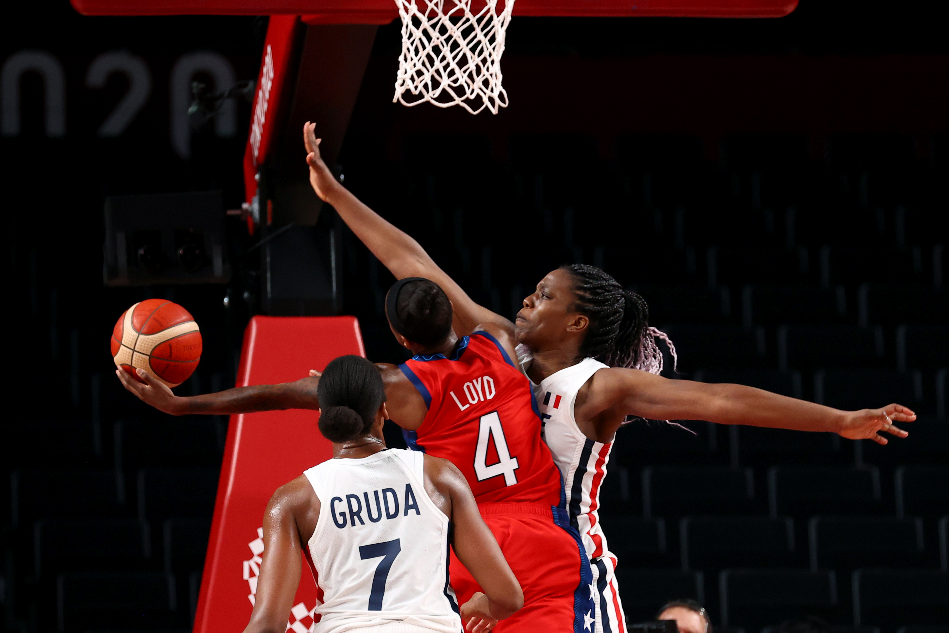 Tokyo 2020 Olympics - Basketball - Women - Group B - France v United States - Saitama Super Arena, Saitama, Japan - August 2, 2021. Jewell Loyd of the United States in action with Sandrine Gruda of France and Endene Miyem of France REUTERS/Brian Snyder