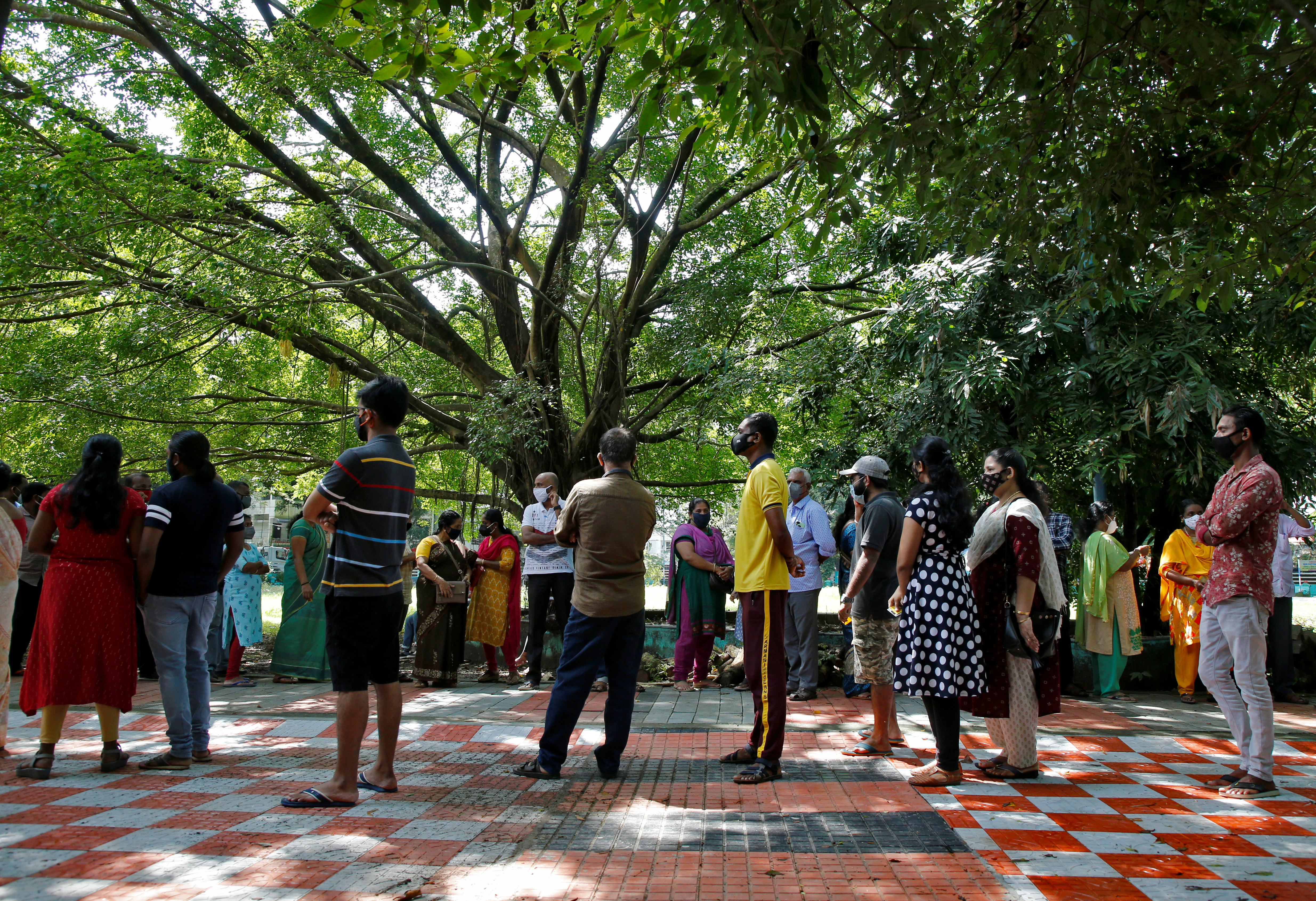 People wait in queues to receive a dose of COVISHIELD, a vaccine against coronavirus disease (COVID-19) manufactured by Serum Institute of India, outside a community centre in Kochi, India, September 7, 2021. REUTERS/Sivaram V