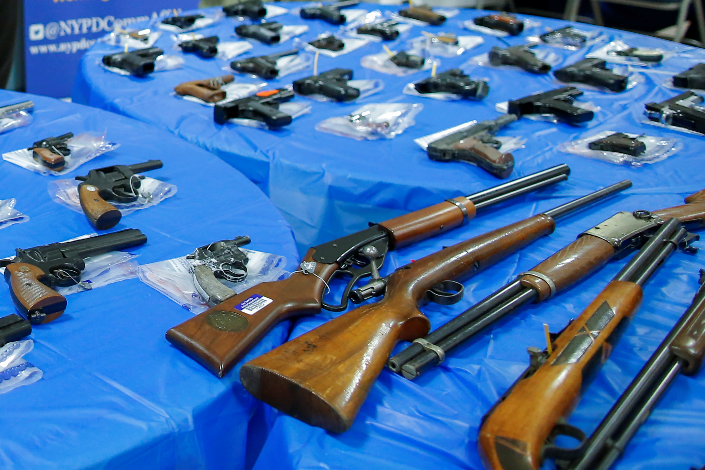 Guns are displayed after a gun buyback event organized by the New York City Police Department (NYPD), in the Queens borough of New York City, U.S., June 12, 2021. REUTERS/Eduardo Munoz