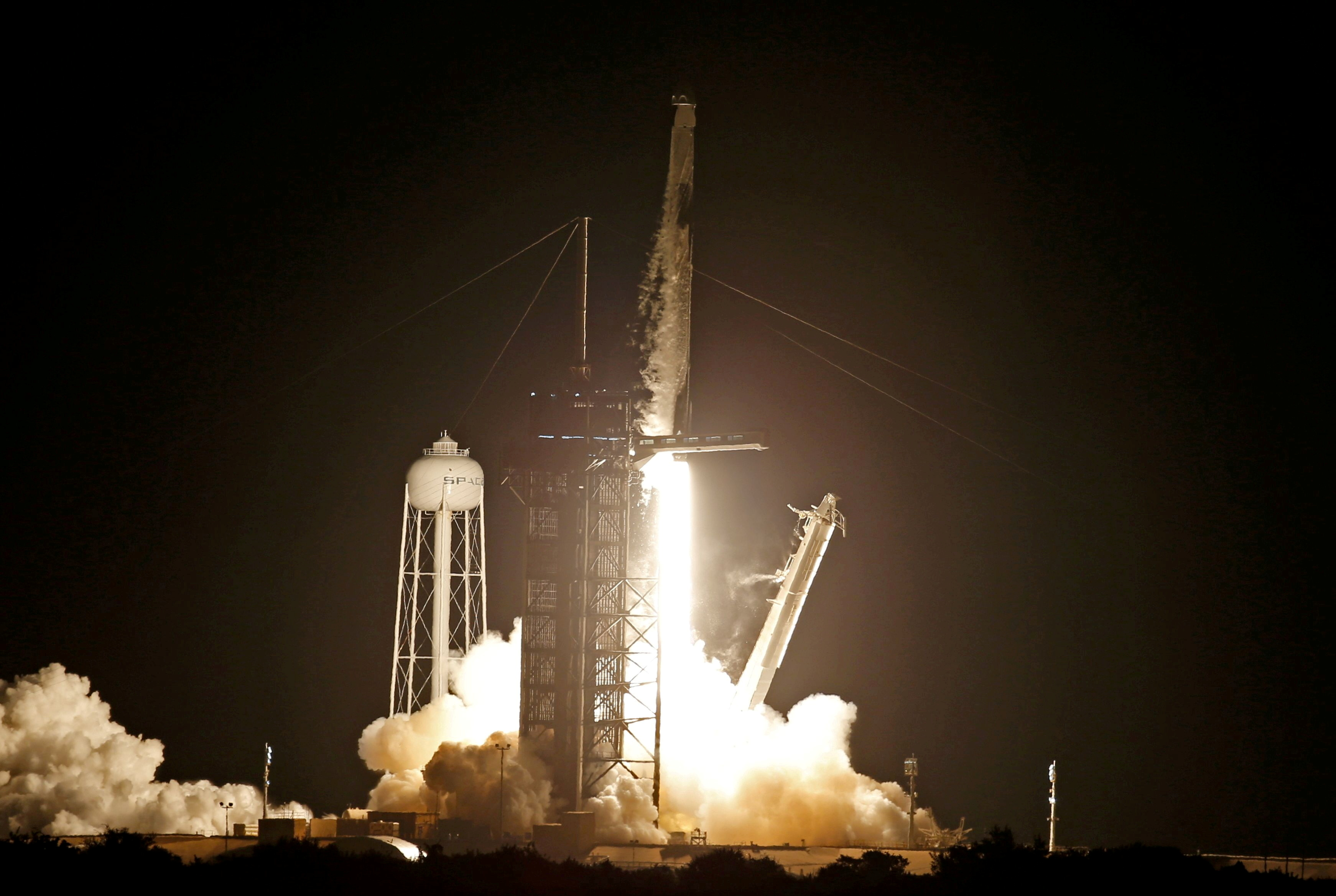 A SpaceX Falcon 9 rocket, with the Crew Dragon capsule, is launched carrying four astronauts on a NASA commercial crew mission at Kennedy Space Center in Cape Canaveral, Florida, September 15, 2021. REUTERS/Thom Baur/File Photo