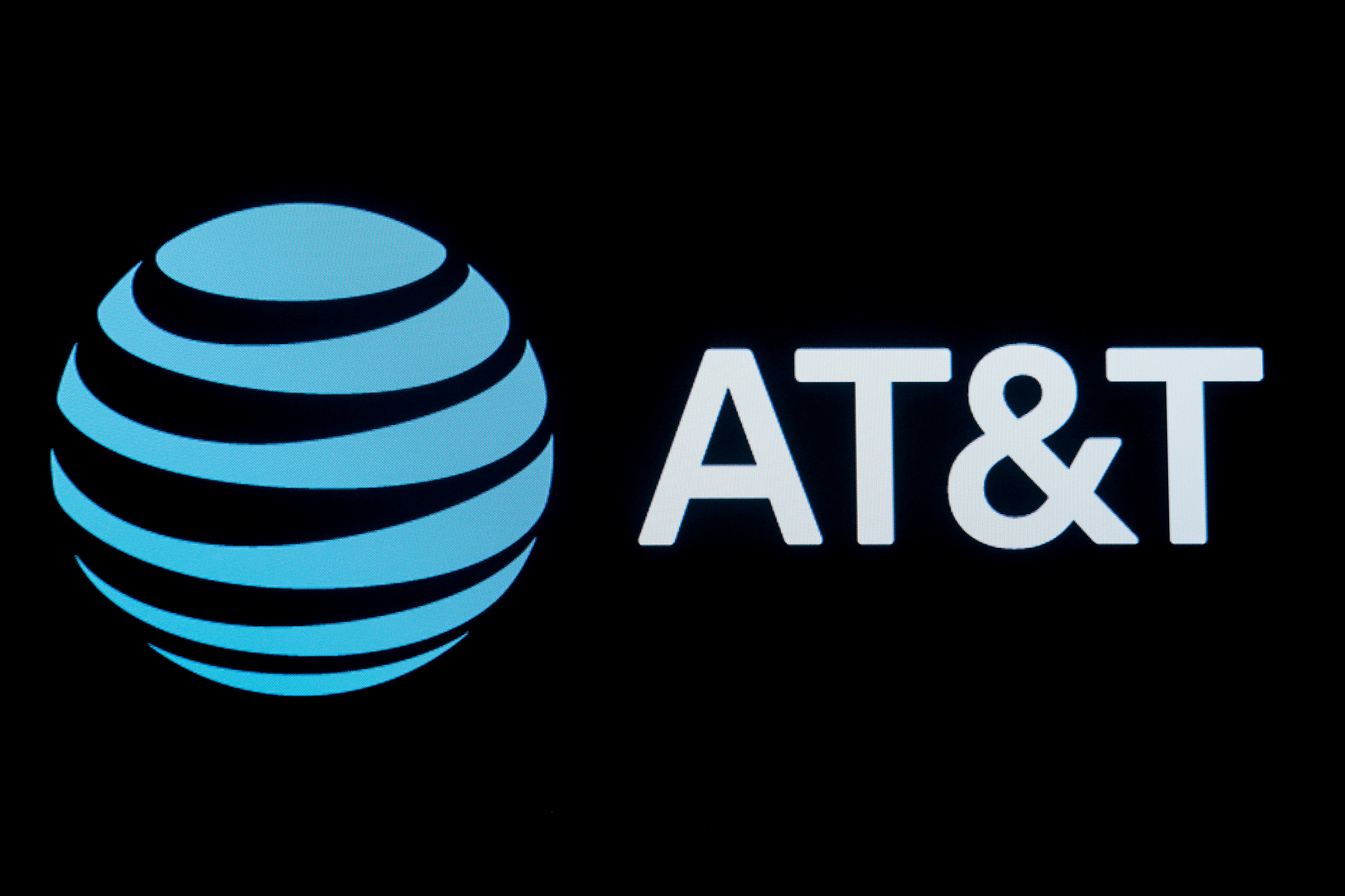 The company logo for AT&T is displayed on a screen on the floor at the New York Stock Exchange (NYSE) in New York, U.S., September 18, 2019. REUTERS/Brendan McDermid/File Photo