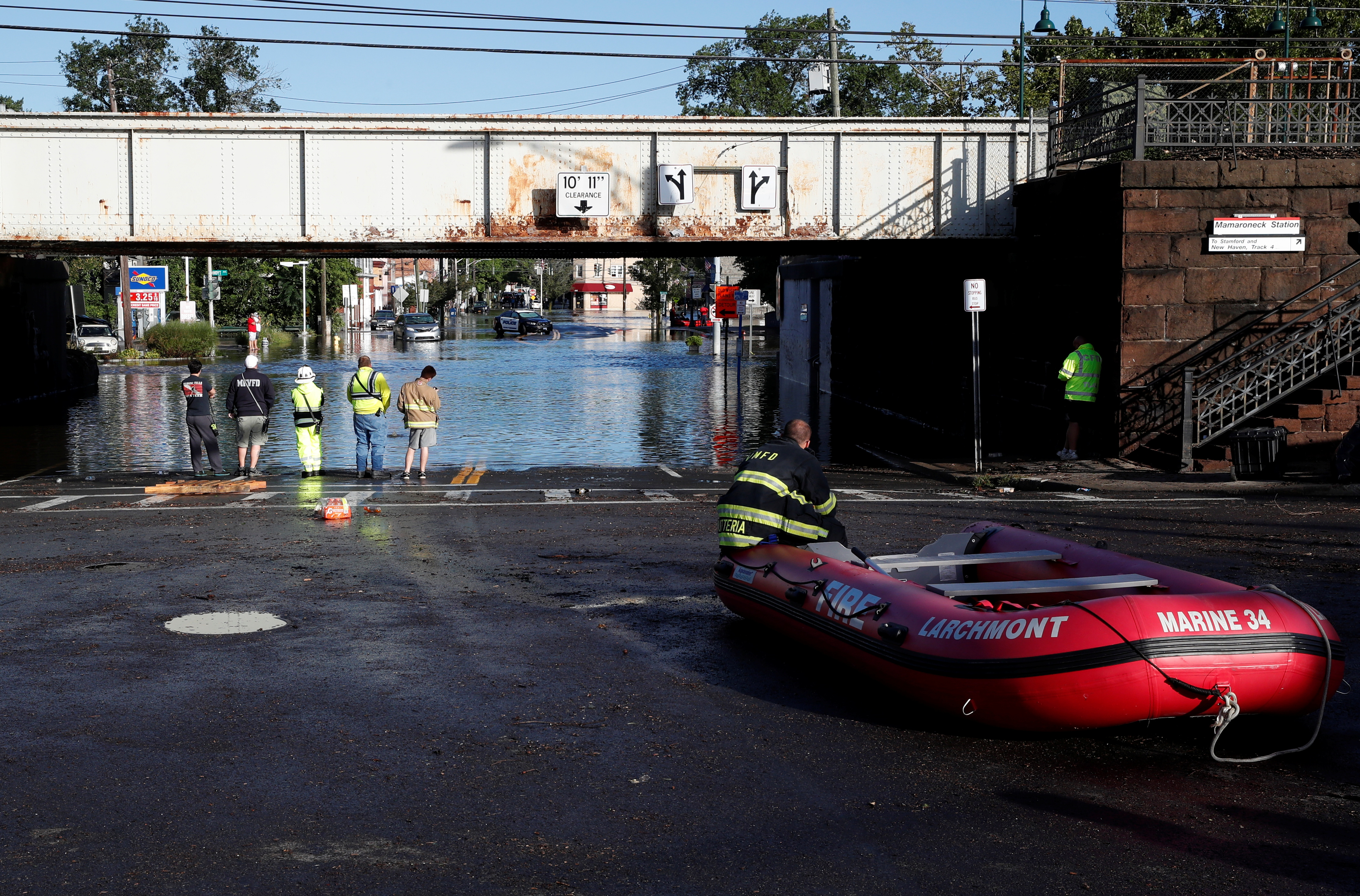 First responders stand by floodwaters to perform rescues of trapped local residents after the remnants of Tropical Storm Ida brought drenching rain, flash floods and tornadoes to parts of the northeast in Mamaroneck, New York, U.S., September 2, 2021. REUTERS/Mike Segar