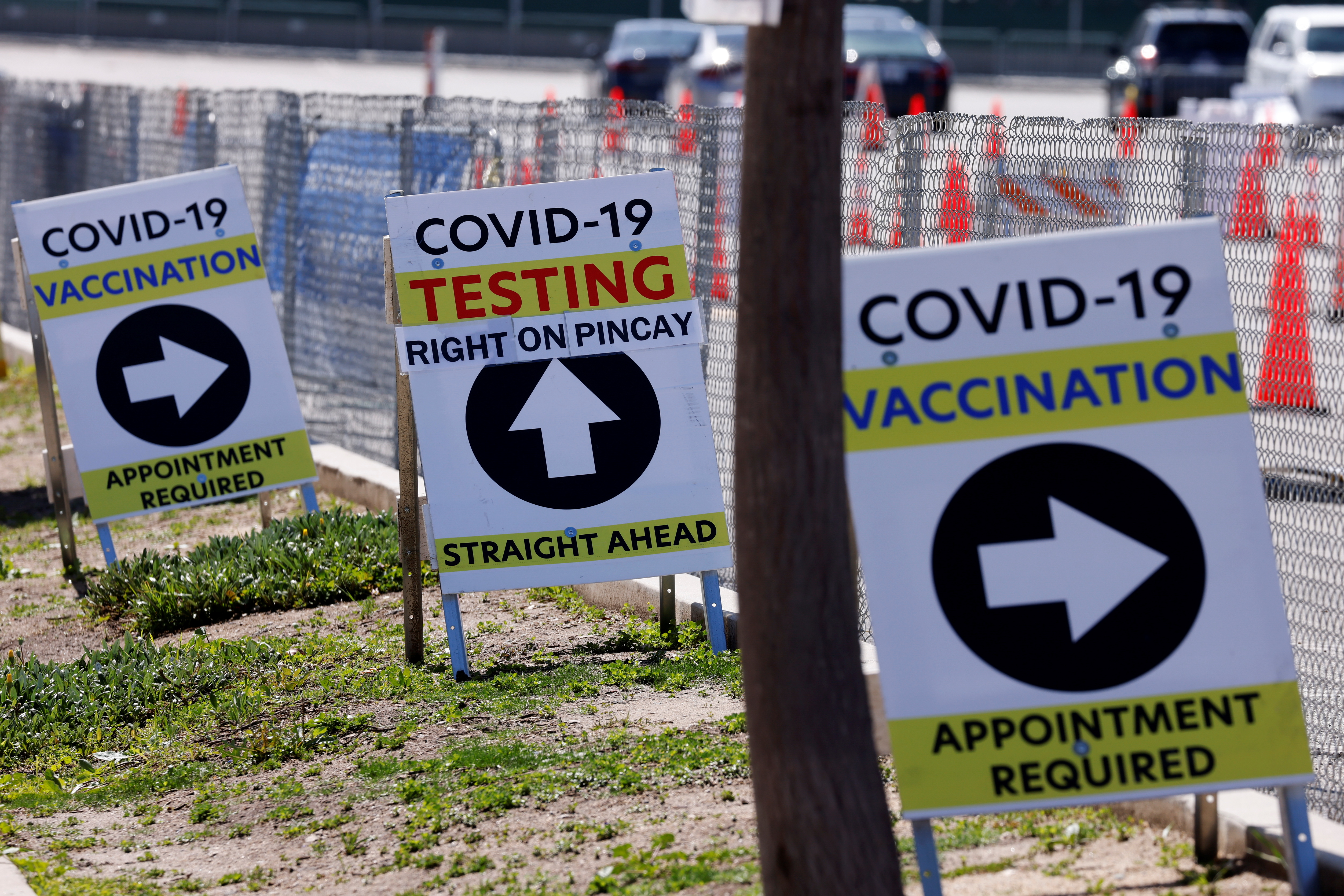 Signs guide the public at a large vaccination and testing site as people with preexisting health conditions are granted access to a vaccination during the outbreak of the coronavirus disease (COVID-19) in Inglewood, California, U.S., March 15, 2021.  REUTERS/Mike Blake