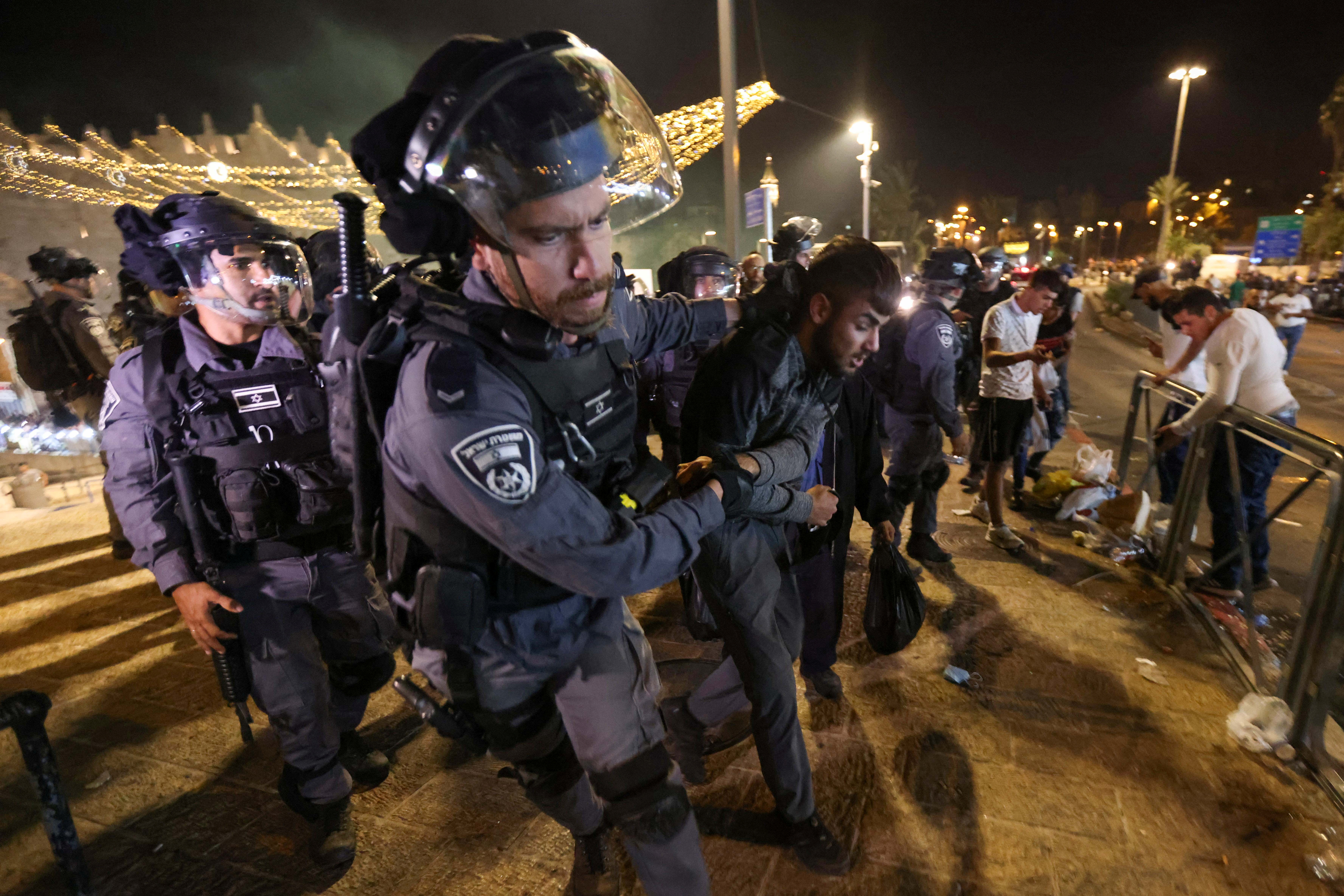 Israeli police detain a Palestinian during clashes at Damascus Gate on Laylat al-Qadr during the holy month of Ramadan, in Jerusalem's Old City, May 8, 2021. REUTERS/Ronen Zvulun