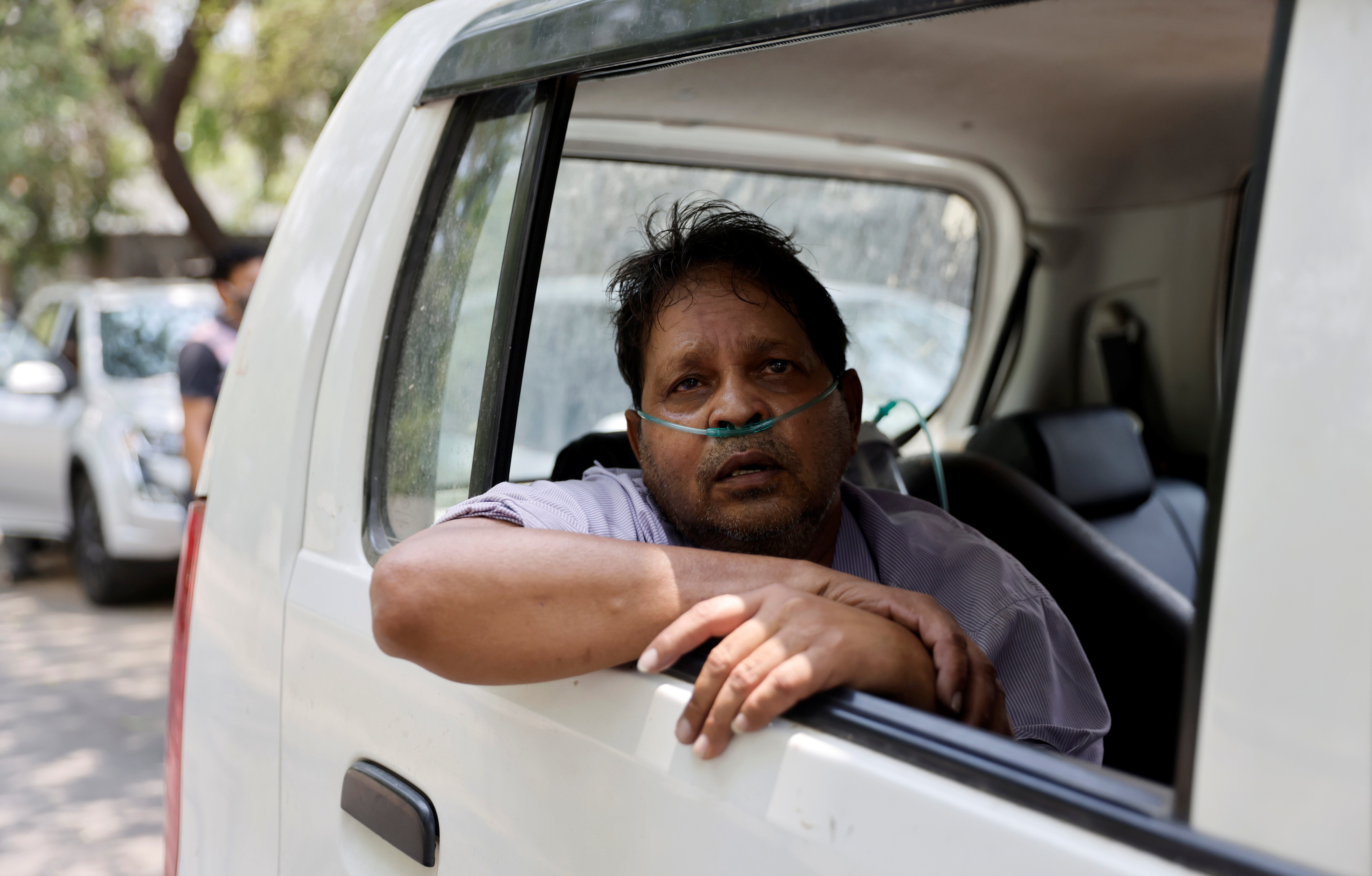 Vijay Gupta, 62, with breathing problem, sits inside a car as he waits to get admission at a COVID-19 hospital for treatment, amidst the spread of the coronavirus disease (COVID-19), in New Delhi, India, May 1, 2021. REUTERS/Danish Siddiqui