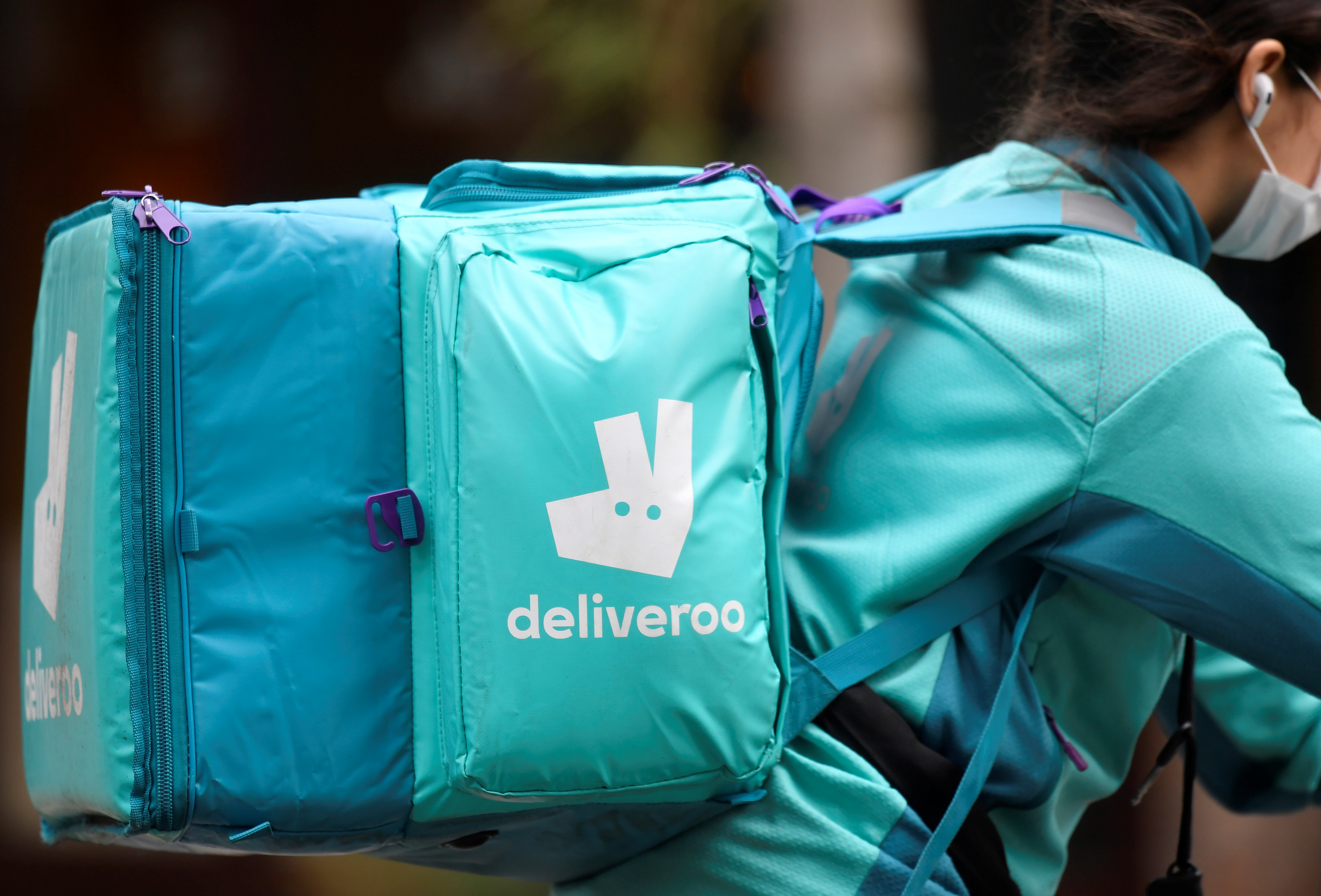 A Deliveroo delivery rider cycles in London, Britain, March 31, 2021. REUTERS/Toby Melville