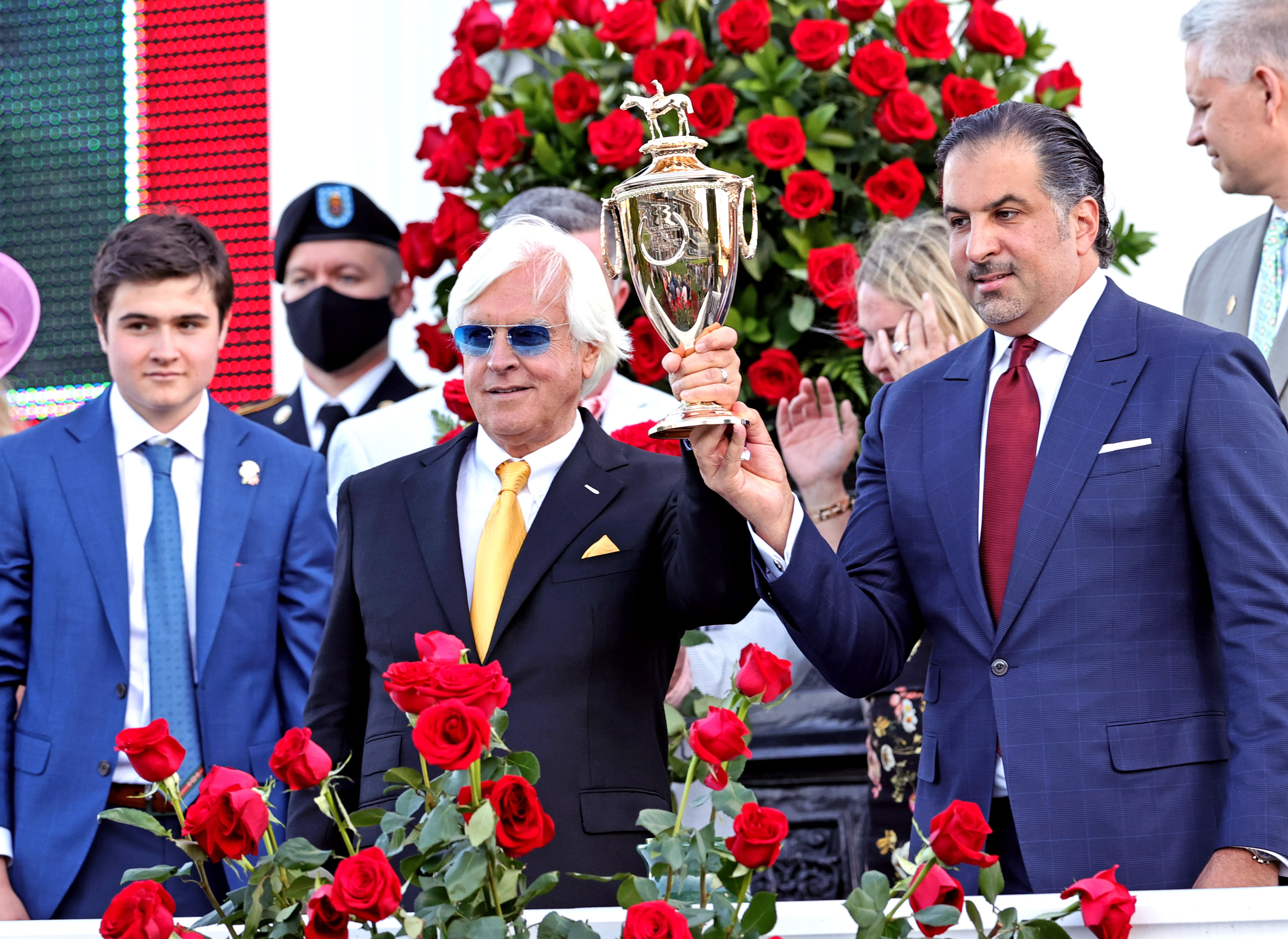 May 1, 2021; Louisville, Kentucky, USA; Medina Spirit owner Amr F. Zedan (right) and trainer Bob Baffert hold the trophy after winning the 147th running of the Kentucky Derby at Churchill Downs. Mandatory Credit: Jim Owens-USA TODAY Sports