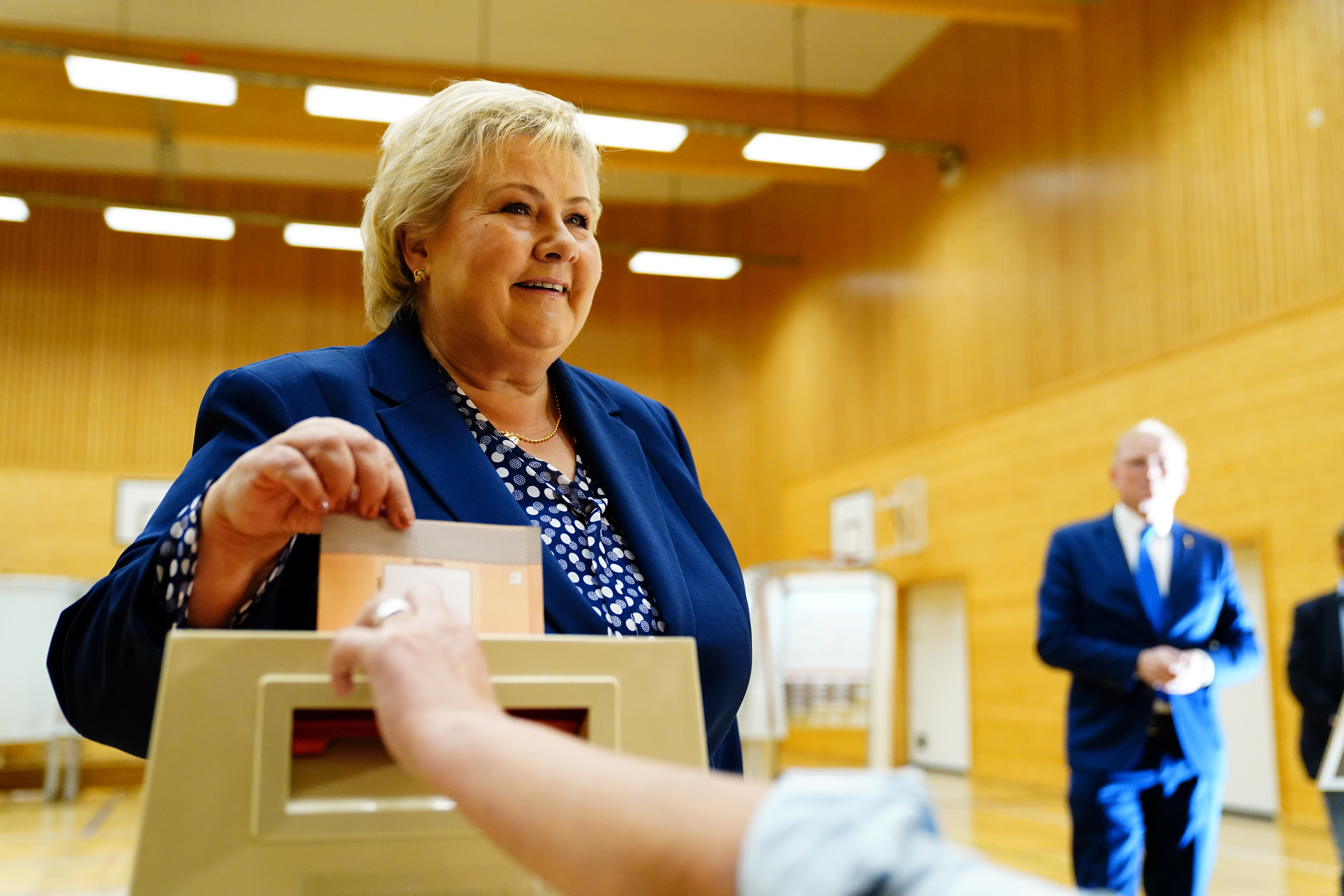 Norwegian Prime Minister Erna Solberg, leader of the Conservative Party, casts her vote in the 2021 parliamentary election at Skjold School in her home town, in Bergen, Norway September 13, 2021. NTB/Hakon Mosvold Larsen via REUTERS