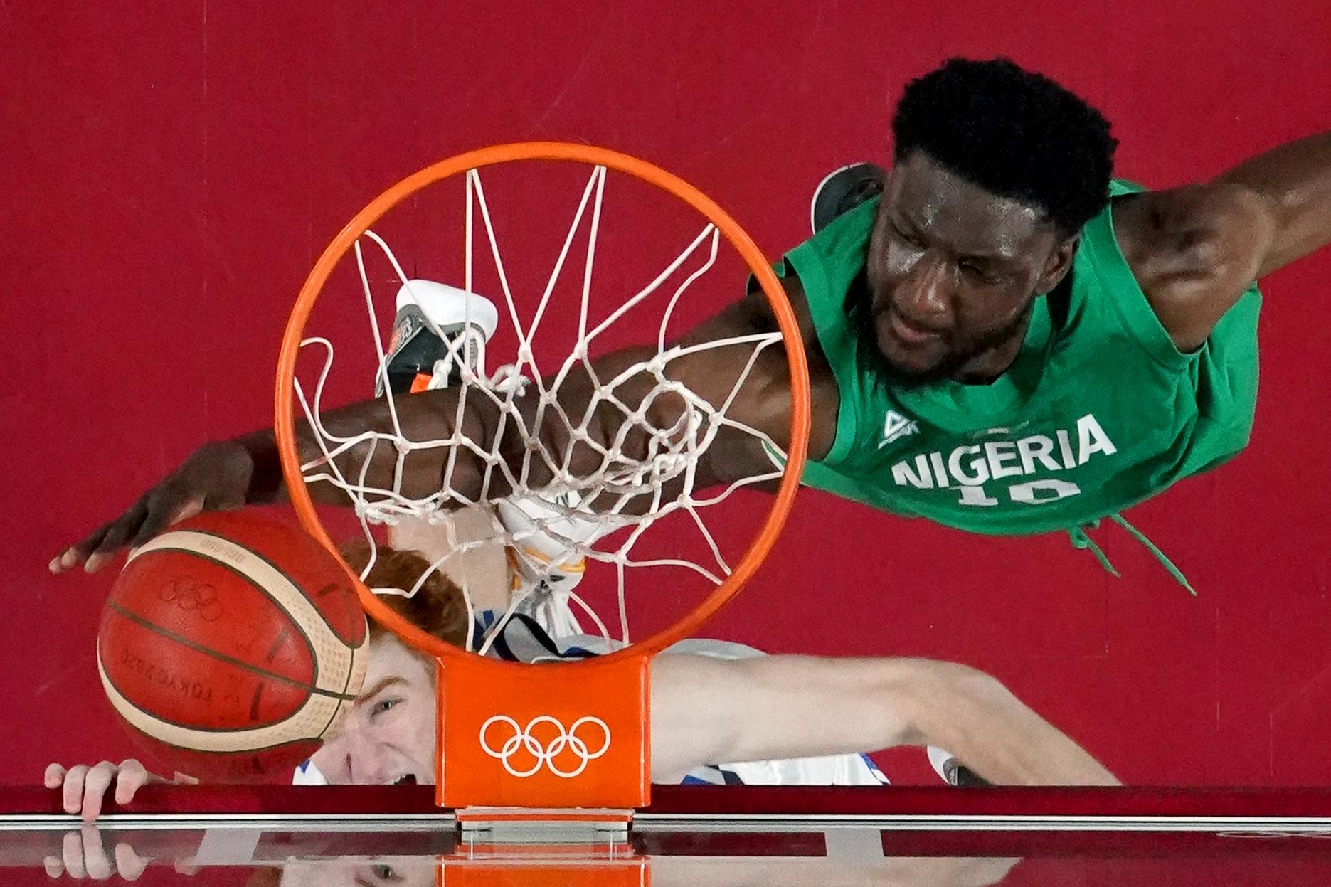 Tokyo 2020 Olympics - Basketball - Men - Group B - Italy v Nigeria - Saitama Super Arena, Saitama, Japan - July 31, 2021. Chimezie Metu of Nigeria in action at the rim with Nicolo Mannion of Italy REUTERS/Brian Snyder