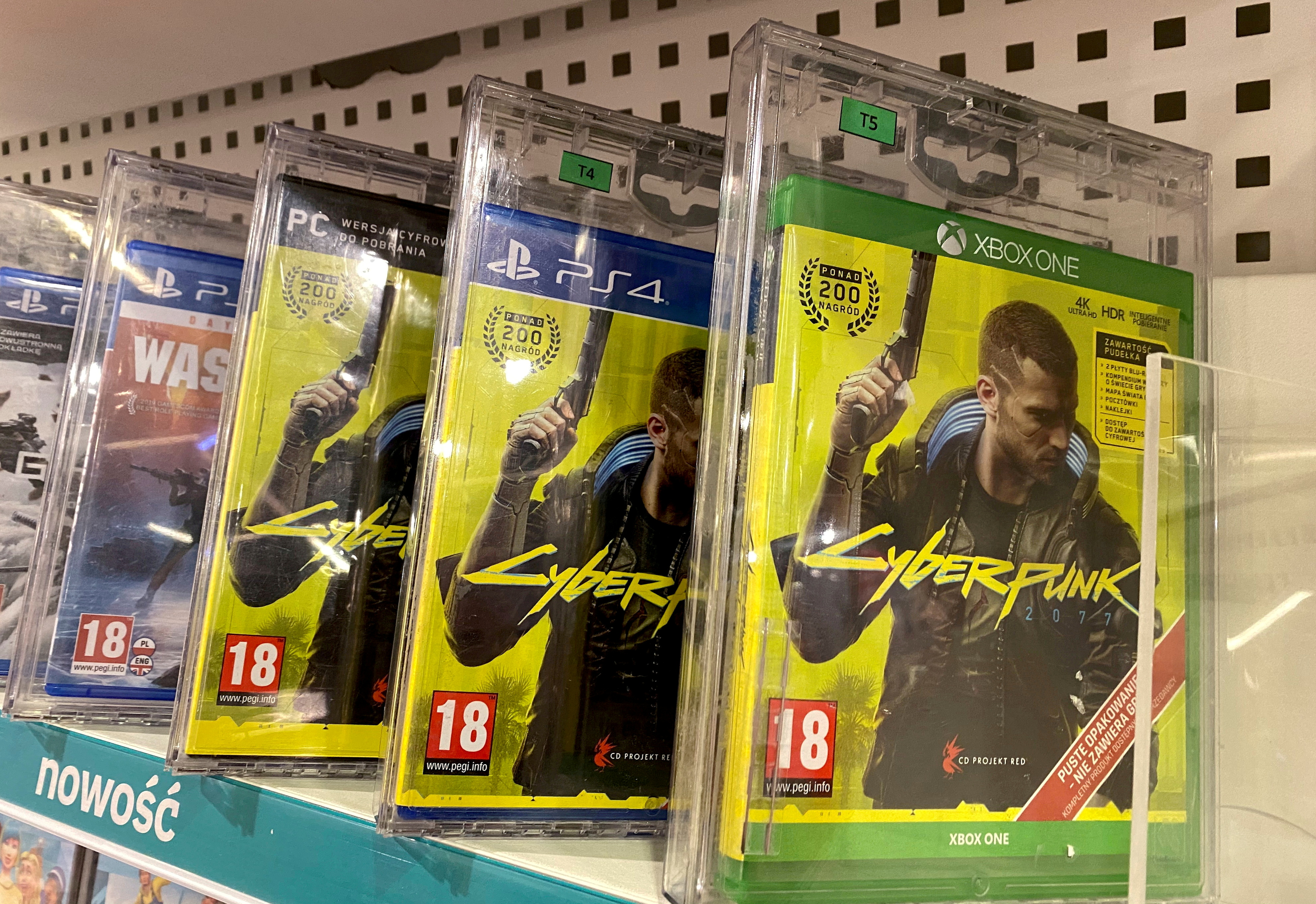 Boxes with CD Projekt's game Cyberpunk 2077 are displayed in Warsaw, Poland, Dec. 14, 2020. REUTERS/Kacper Pempel/File Photo