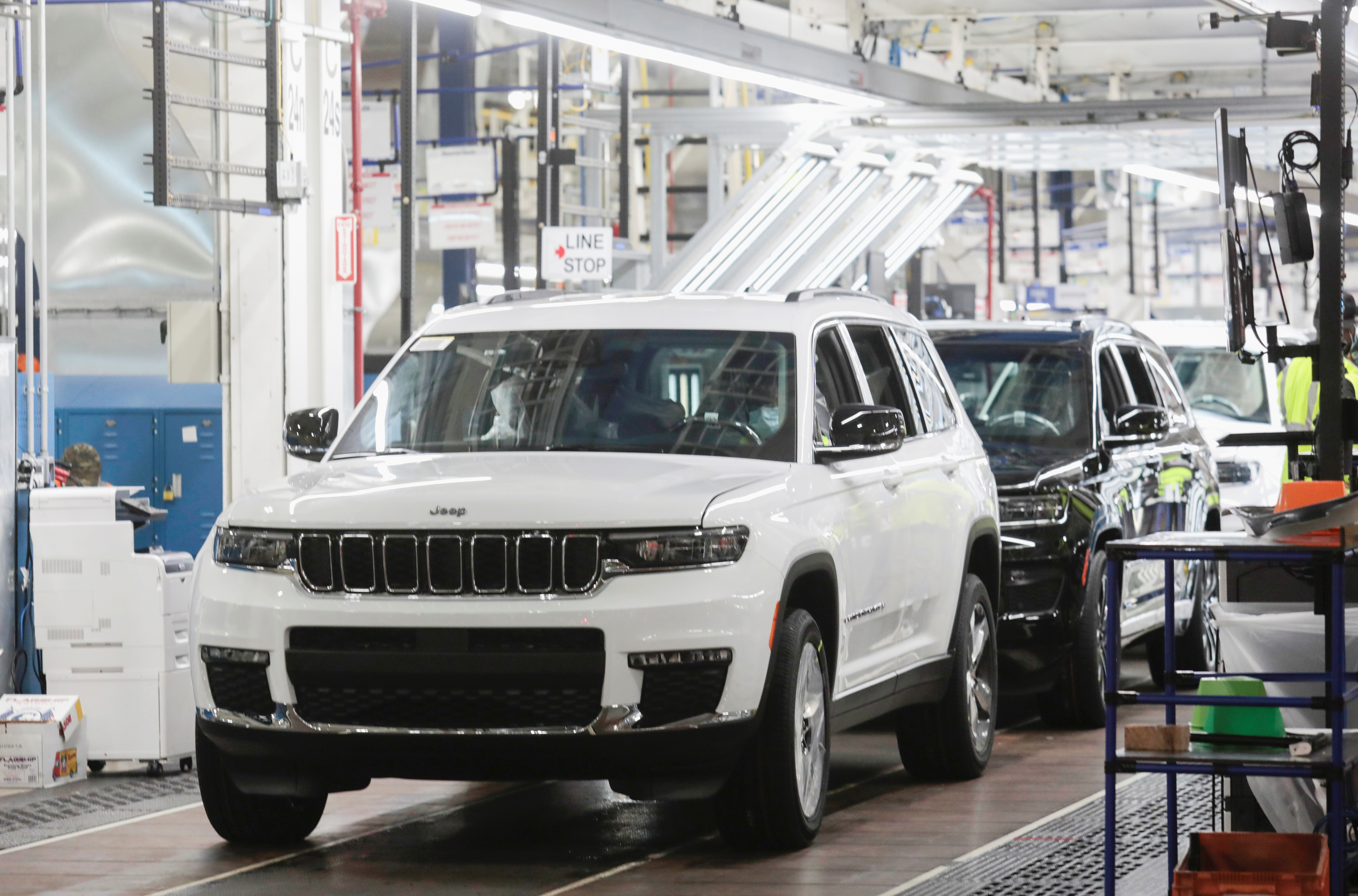 2021 Jeep Grand Cherokee L vehicles are seen on the final line at the Detroit Assembly Complex - Mack Plant in Detroit, Michigan, U.S., June 10, 2021. Picture taken June 10, 2021. REUTERS/Rebecca Cook