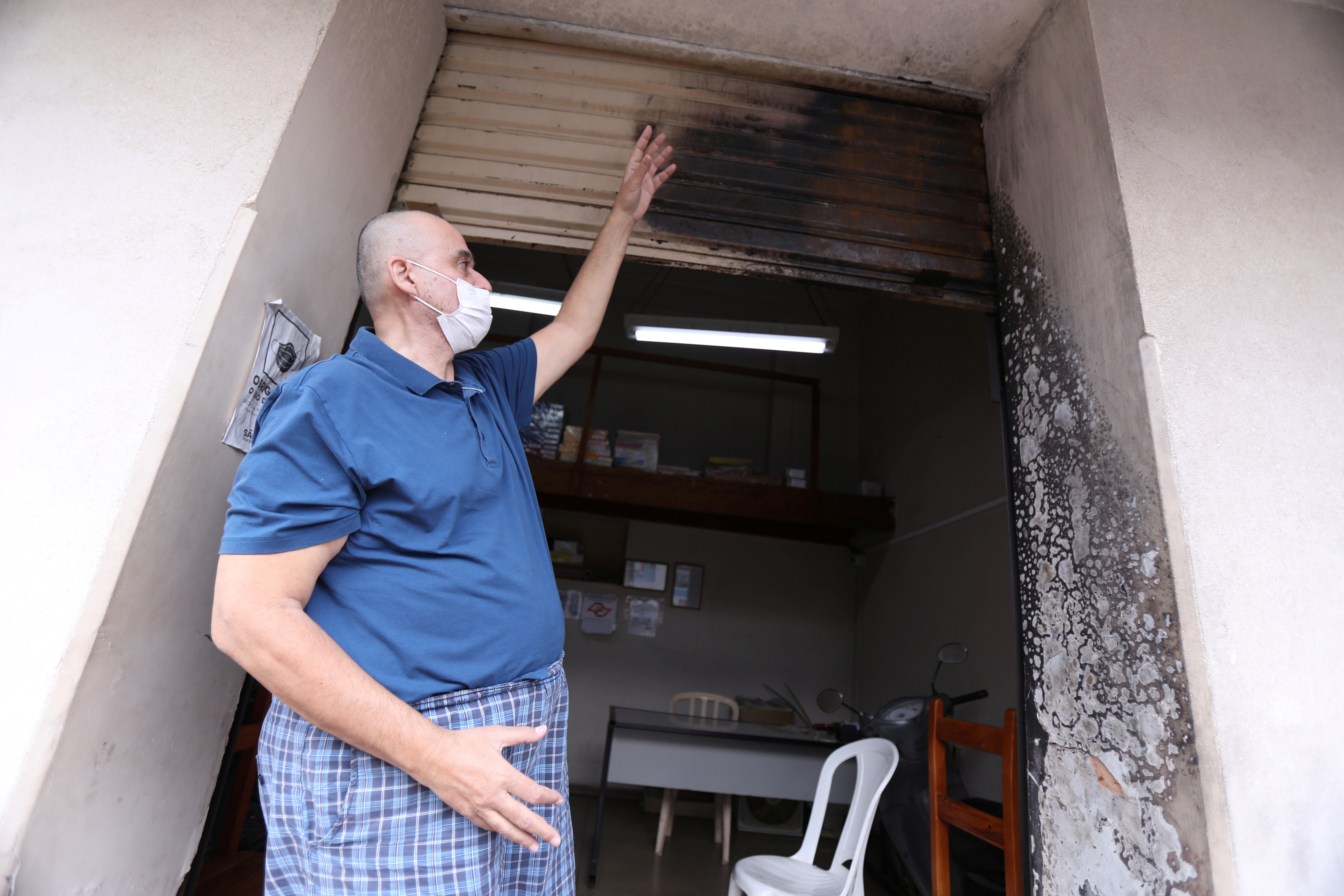 Jose Antonio Arantes, a local newspaper editor and radio host, who had his house set on fire by a supporter of Brazil's President Jair Bolsonaro, gestures in front of his office amid the coronavirus disease (COVID-19) pandemic in Olimpia, Sao Paulo state, Brazil, June 9, 2021. REUTERS/Leonardo Benassatto