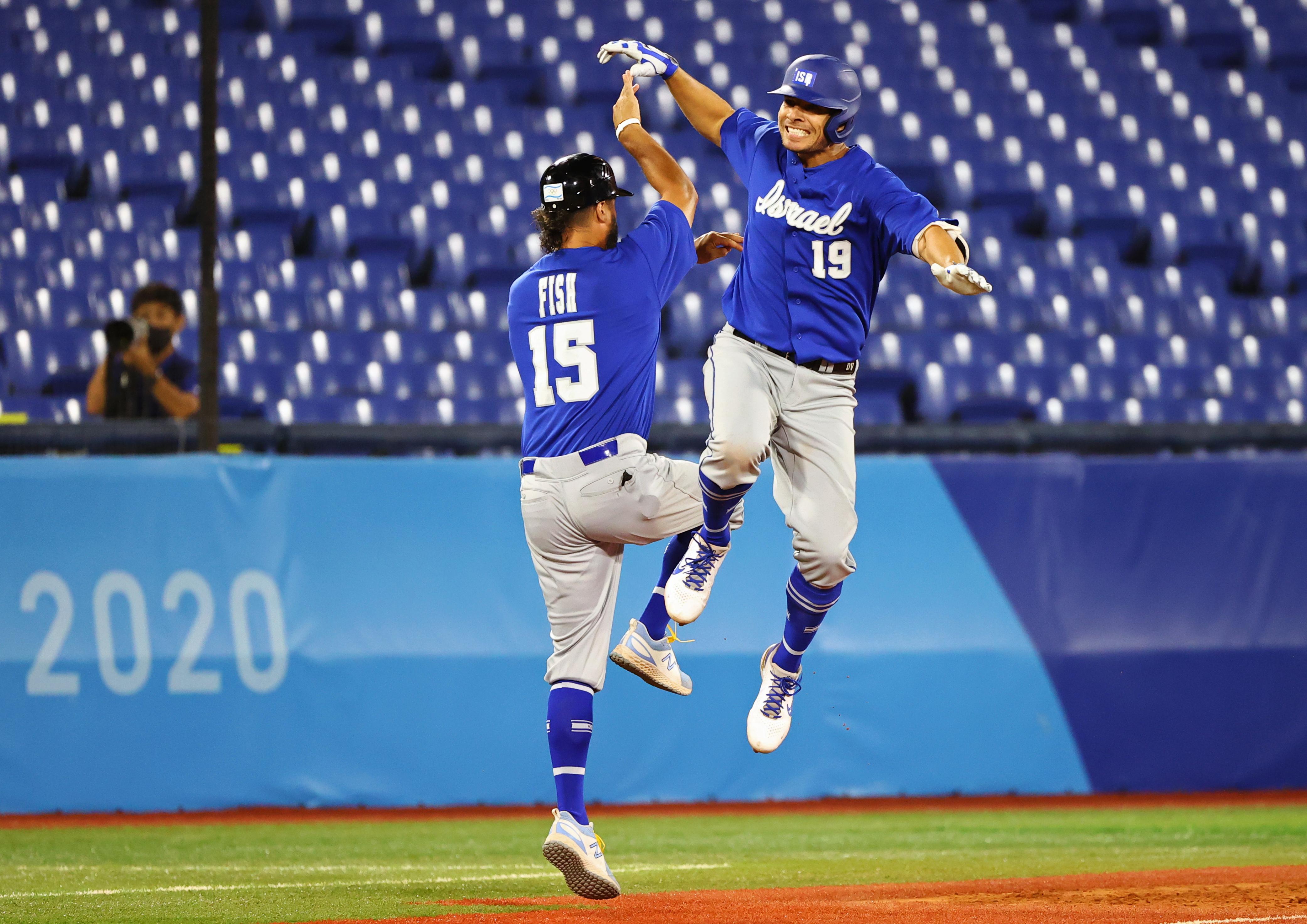 Tokyo 2020 Olympics - Baseball - Men - Round 1 Repechage - Israel v Dominican Republic - Yokohama Baseball Stadium, Yokohama, Japan - August 3, 2021. Danny Valencia of Israel celebrates home run with coach Nate Fish. REUTERS/Jorge Silva
