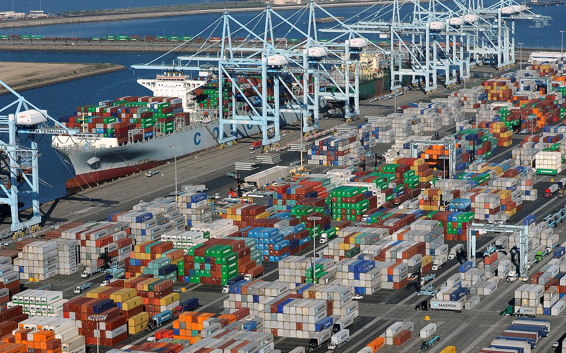 Shipping containers sit at the ports of Los Angeles and Long Beach, California in this aerial photo taken February 6, 2015.  REUTERS/Bob Riha, Jr./File Photo