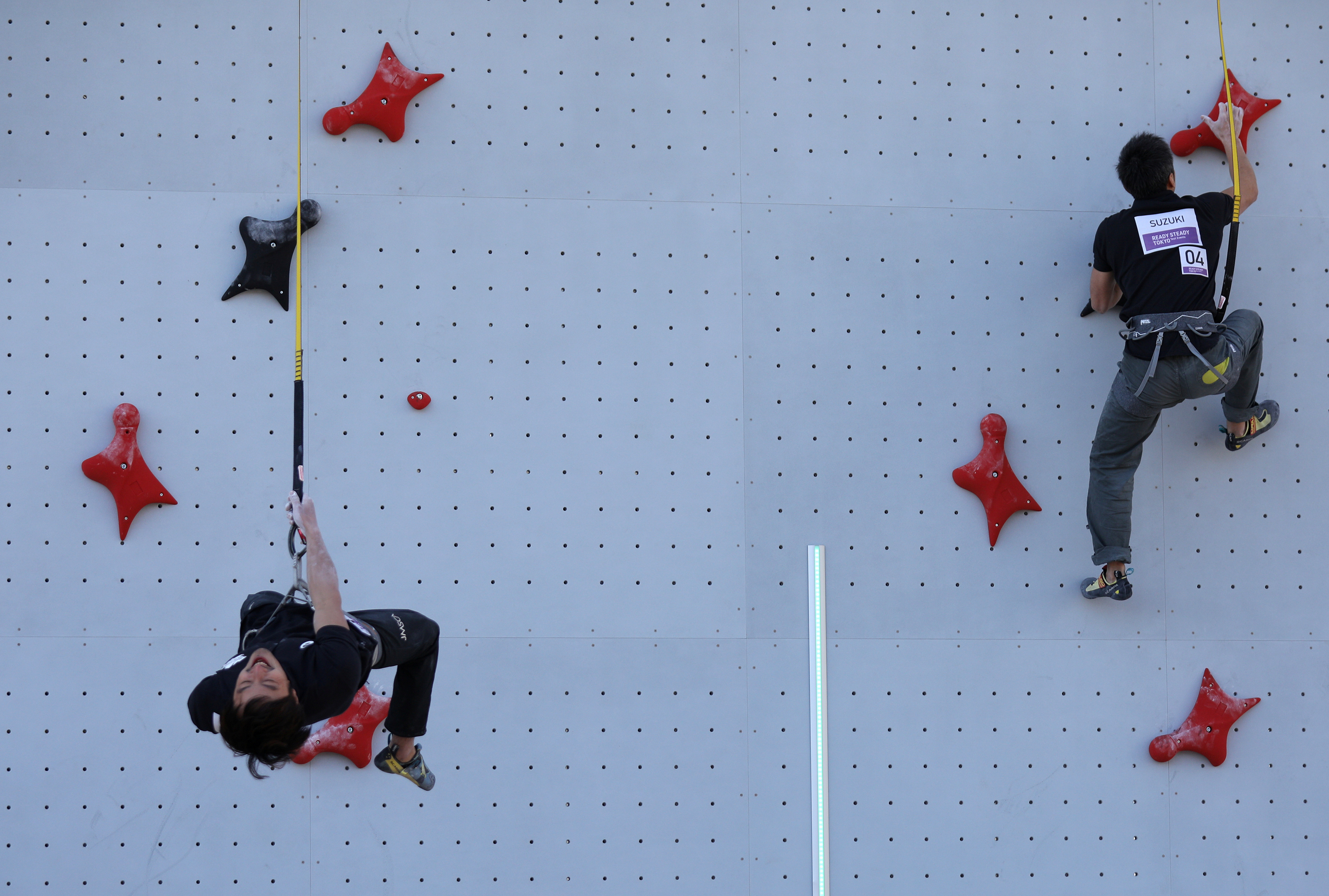 Tokyo 2020 staff participate in a test event for the sports climbing, replacing the athletes due to concerns over the spread of coronavirus at Aomi Urban Sports Park in Tokyo, Japan, March 6, 2020. REUTERS/Stoyan Nenov