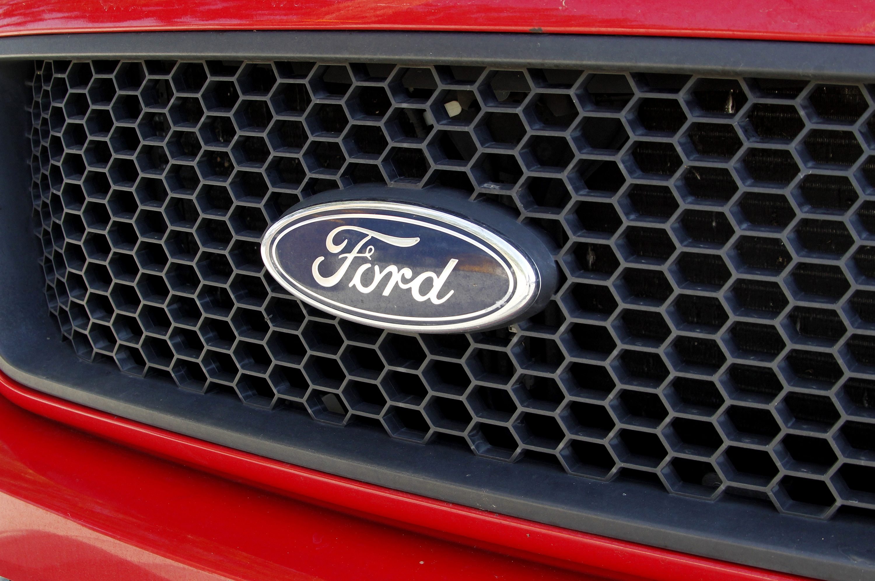 The Ford logo is seen on a Ford F-150 truck parked in Burbank, California April 14, 2011. REUTERS/Fred Prouser