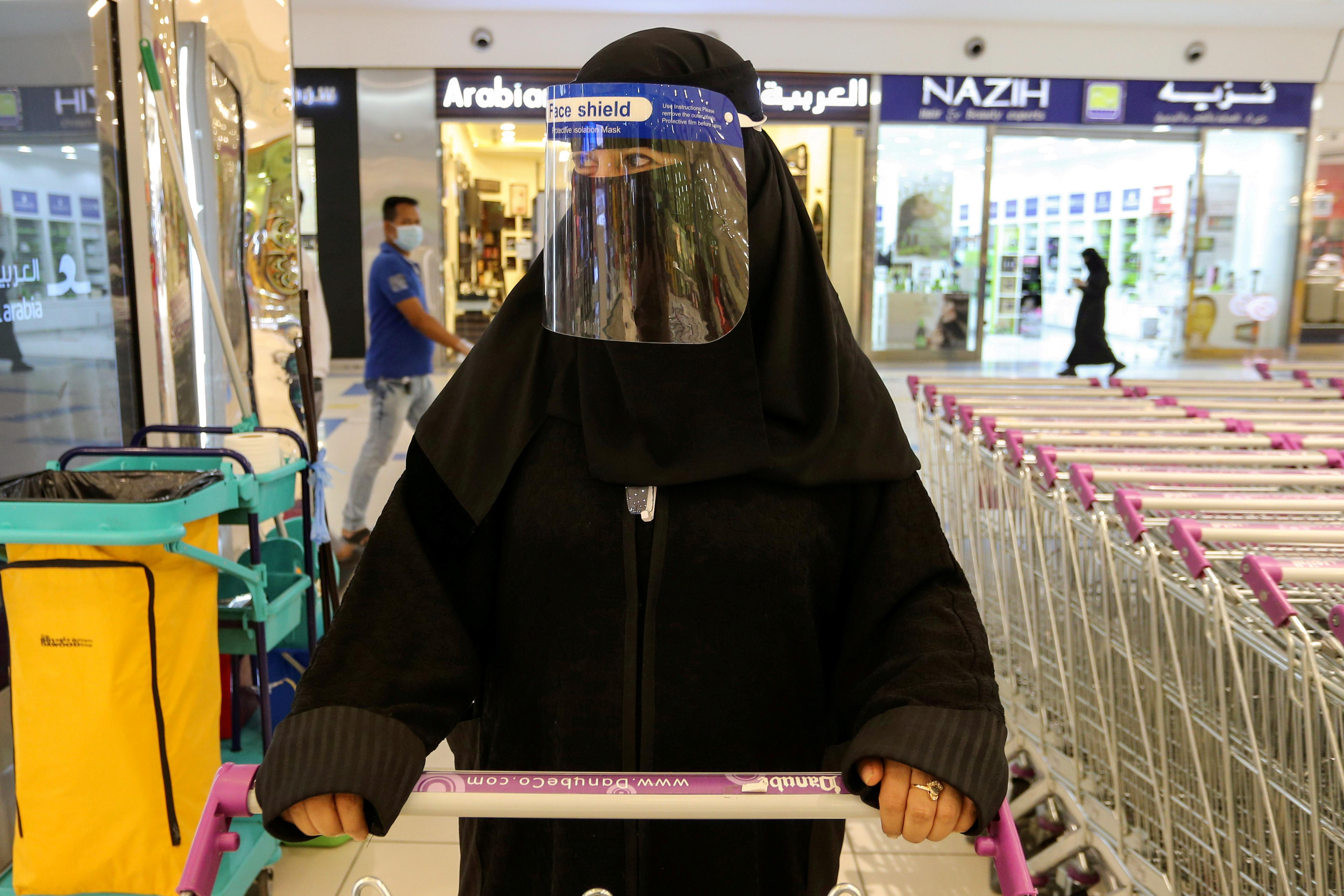A Saudi woman, wearing a face shield, shops at a supermarket, following the outbreak of the coronavirus disease (COVID-19) in Riyadh, Saudi Arabia June 14, 2020. REUTERS/Ahmed Yosri