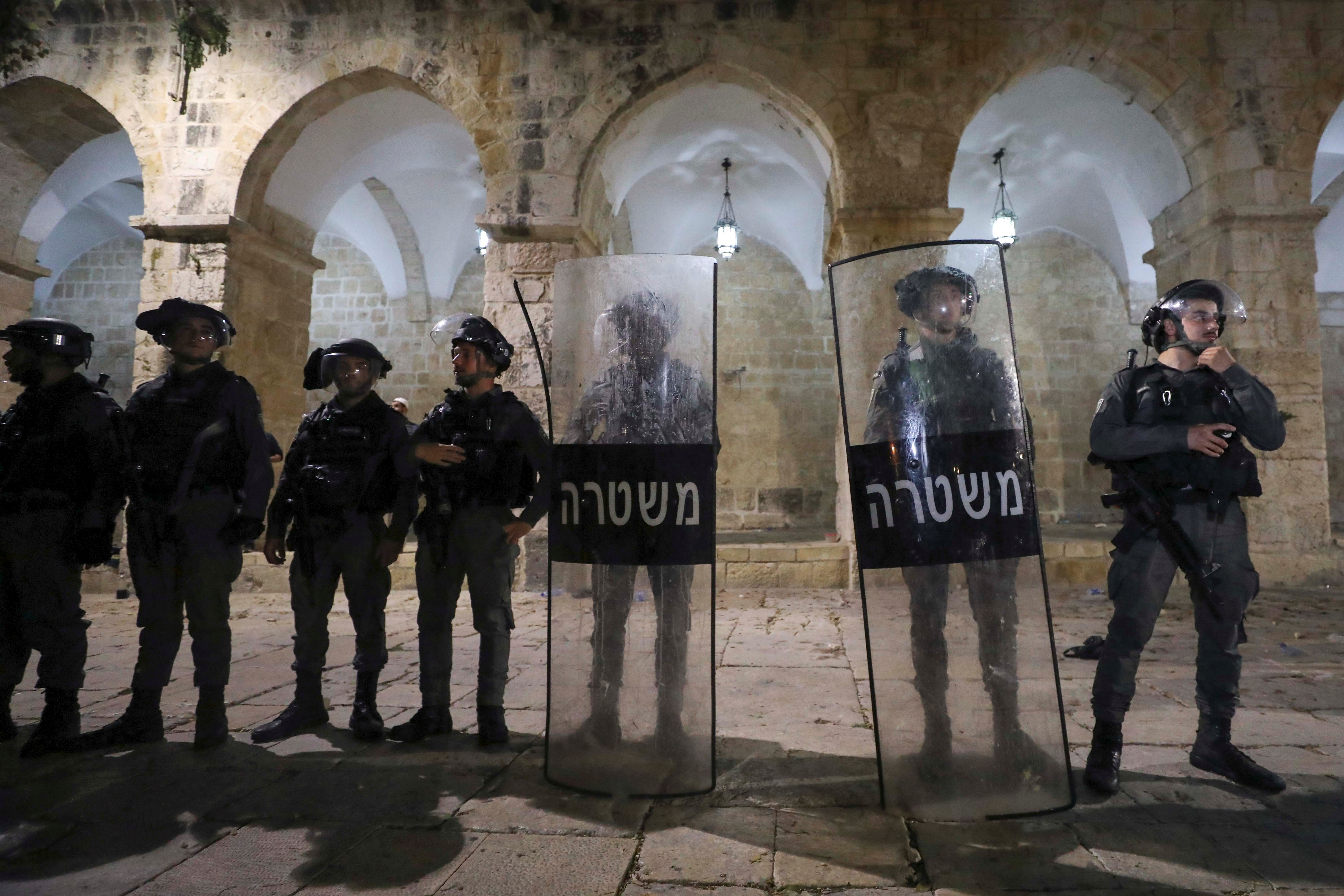 Israeli police keep guard during clashes with Palestinians at the compound that houses Al-Aqsa Mosque, known to Muslims as Noble Sanctuary and to Jews as Temple Mount, amid tension over the possible eviction of several Palestinian families from homes on land claimed by Jewish settlers in the Sheikh Jarrah neighbourhood, in Jerusalem's Old City, May 7, 2021. REUTERS/Ammar Awad