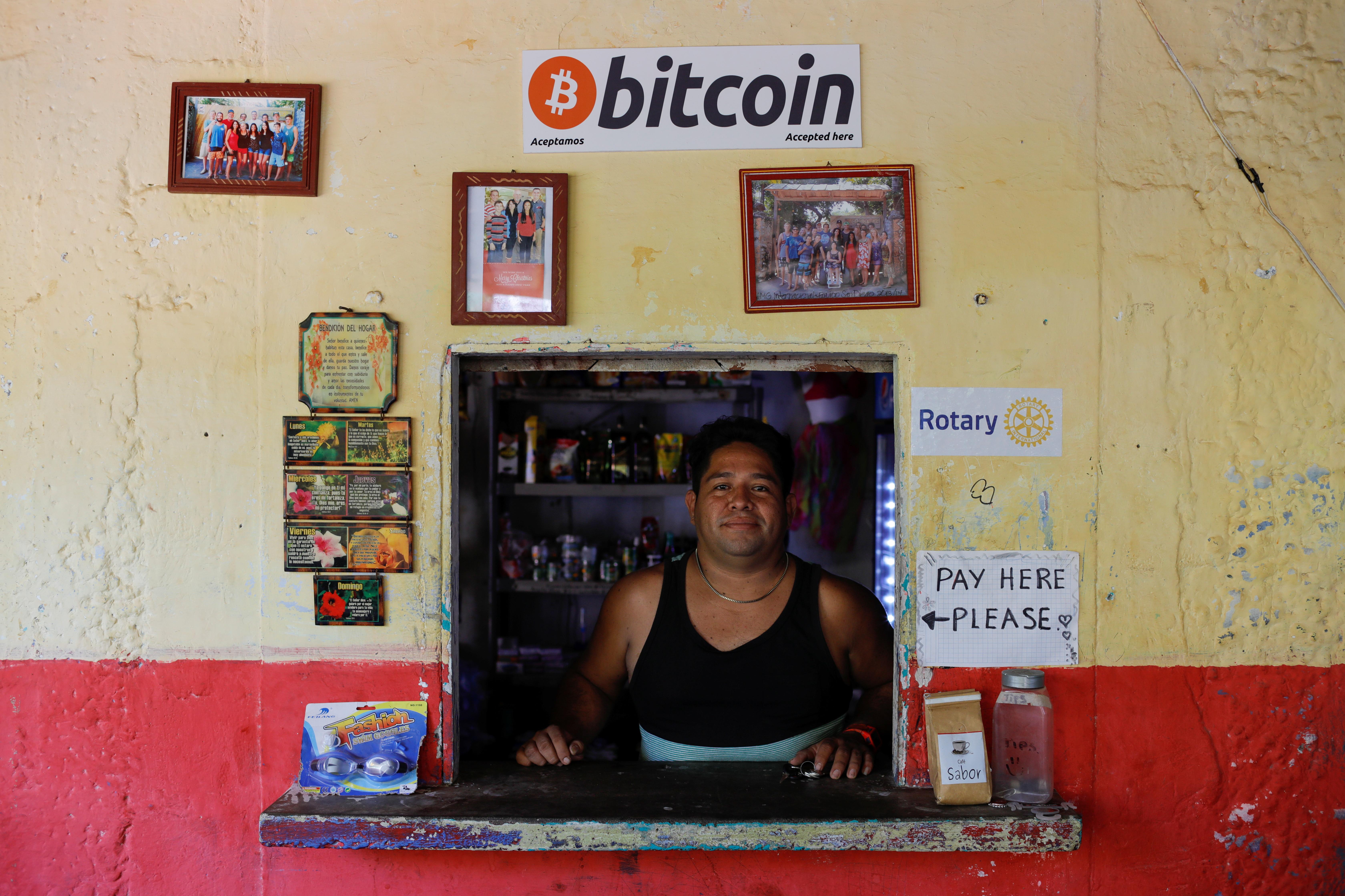 Roberto Carlos Silva, owner of La Zontena store, poses at his business where he accepts Bitcoins at El Zonte Beach in Chiltiupan, El Salvador June 8, 2021. REUTERS/Jose Cabezas